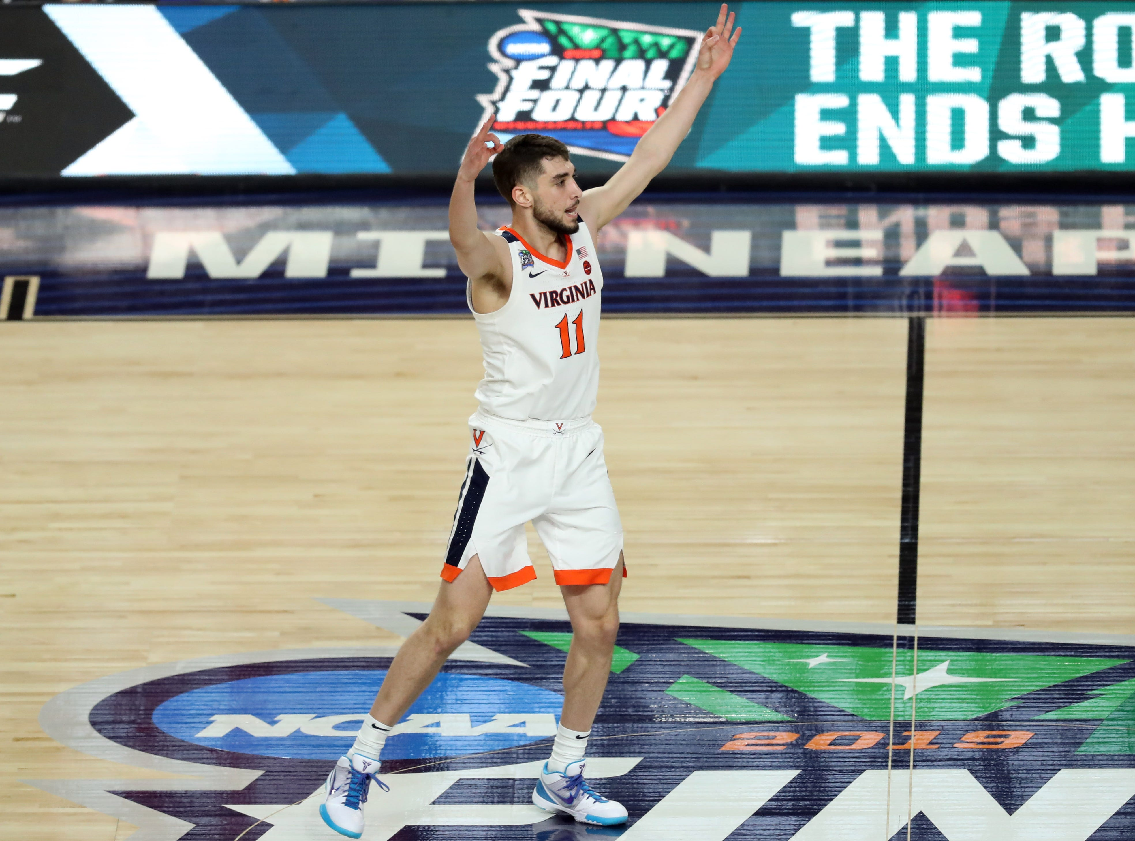 Apr 8, 2019; Minneapolis, MN, USA; Virginia Cavaliers guard Ty Jerome (11) celebrates after a three point shot during the first half against the Texas Tech Red Raiders in the championship game of the 2019 men's Final Four at US Bank Stadium. Mandatory Credit: Brace Hemmelgarn-USA TODAY Sports