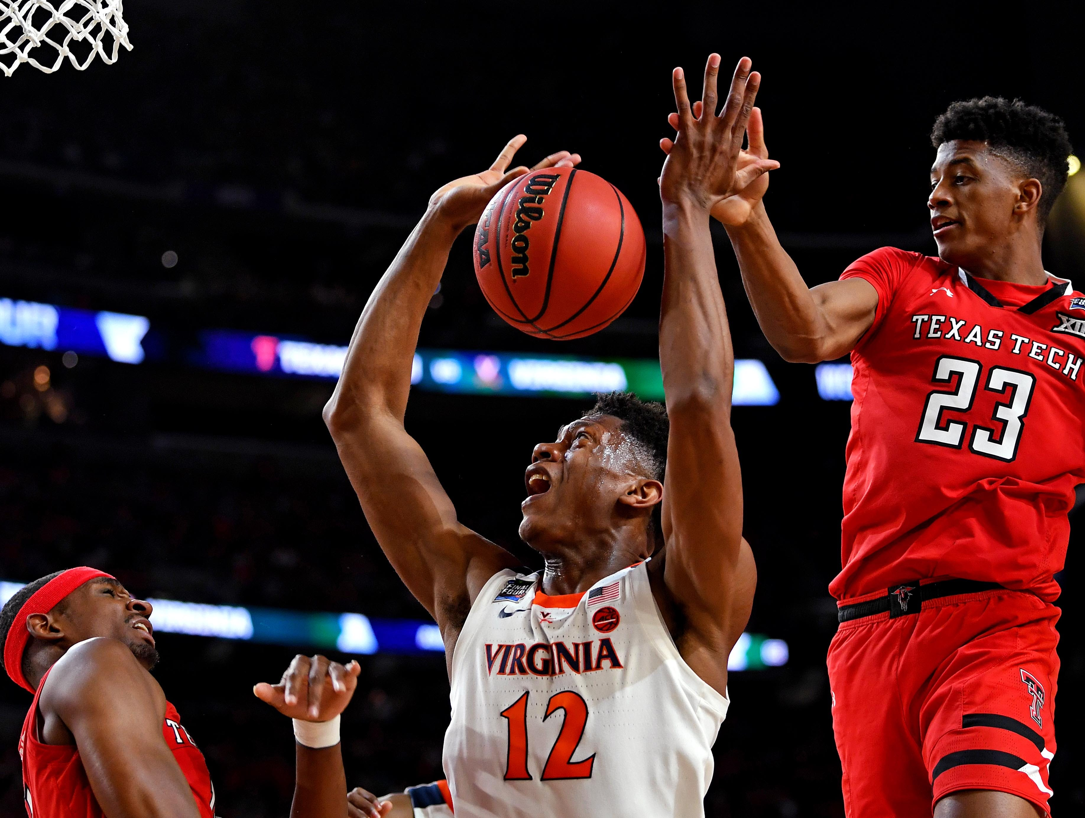 Apr 8, 2019; Minneapolis, MN, USA; Texas Tech Red Raiders guard Jarrett Culver (23) blocks a shot  by Virginia Cavaliers guard De'Andre Hunter (12) during the first halfin the championship game of the 2019 men's Final Four at US Bank Stadium. Mandatory Credit: Bob Donnan-USA TODAY Sports