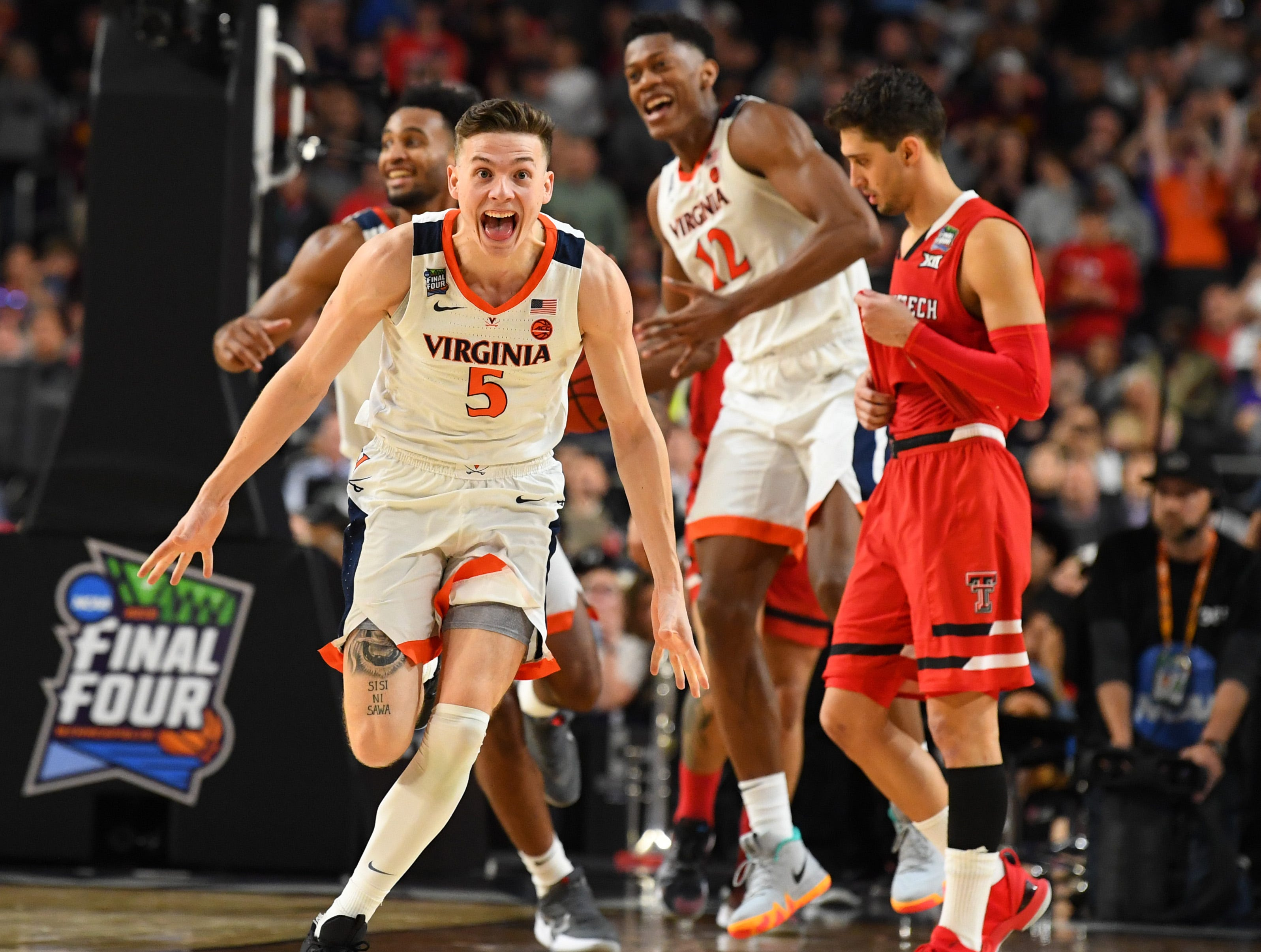 Apr 8, 2019; Minneapolis, MN, USA; Virginia Cavaliers guard Kyle Guy (5) celebrate winning the game over the Texas Tech Red Raiders in overtime in the championship game of the 2019 men's Final Four at US Bank Stadium. Mandatory Credit: Robert Deutsch-USA TODAY Sports