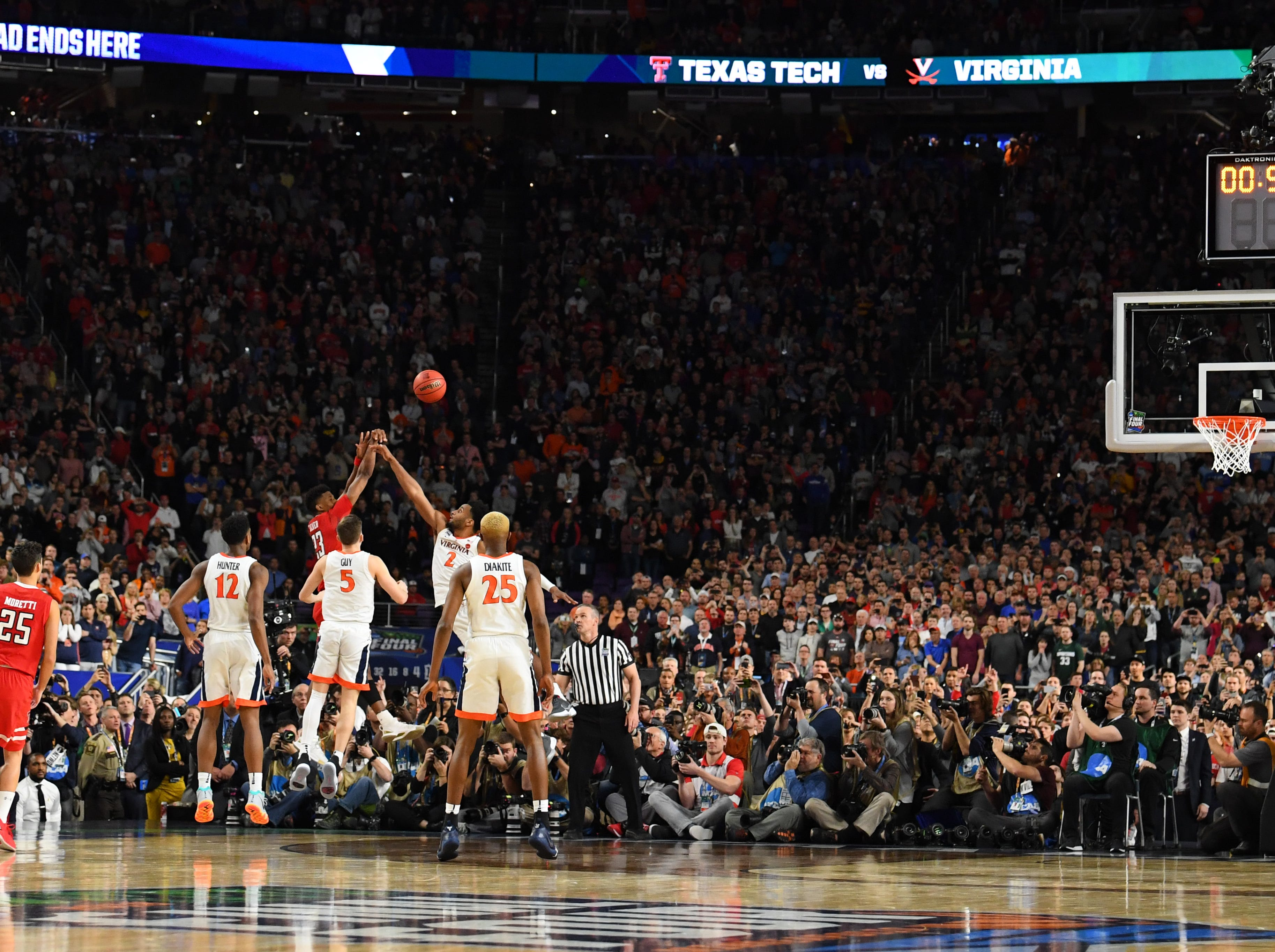 Apr 8, 2019; Minneapolis, MN, USA; Virginia Cavaliers guard Braxton Key (2) blocks the final shot in regulation by Texas Tech Red Raiders guard Jarrett Culver (23) in the championship game of the 2019 men's Final Four at US Bank Stadium. Mandatory Credit: Robert Deutsch-USA TODAY Sports