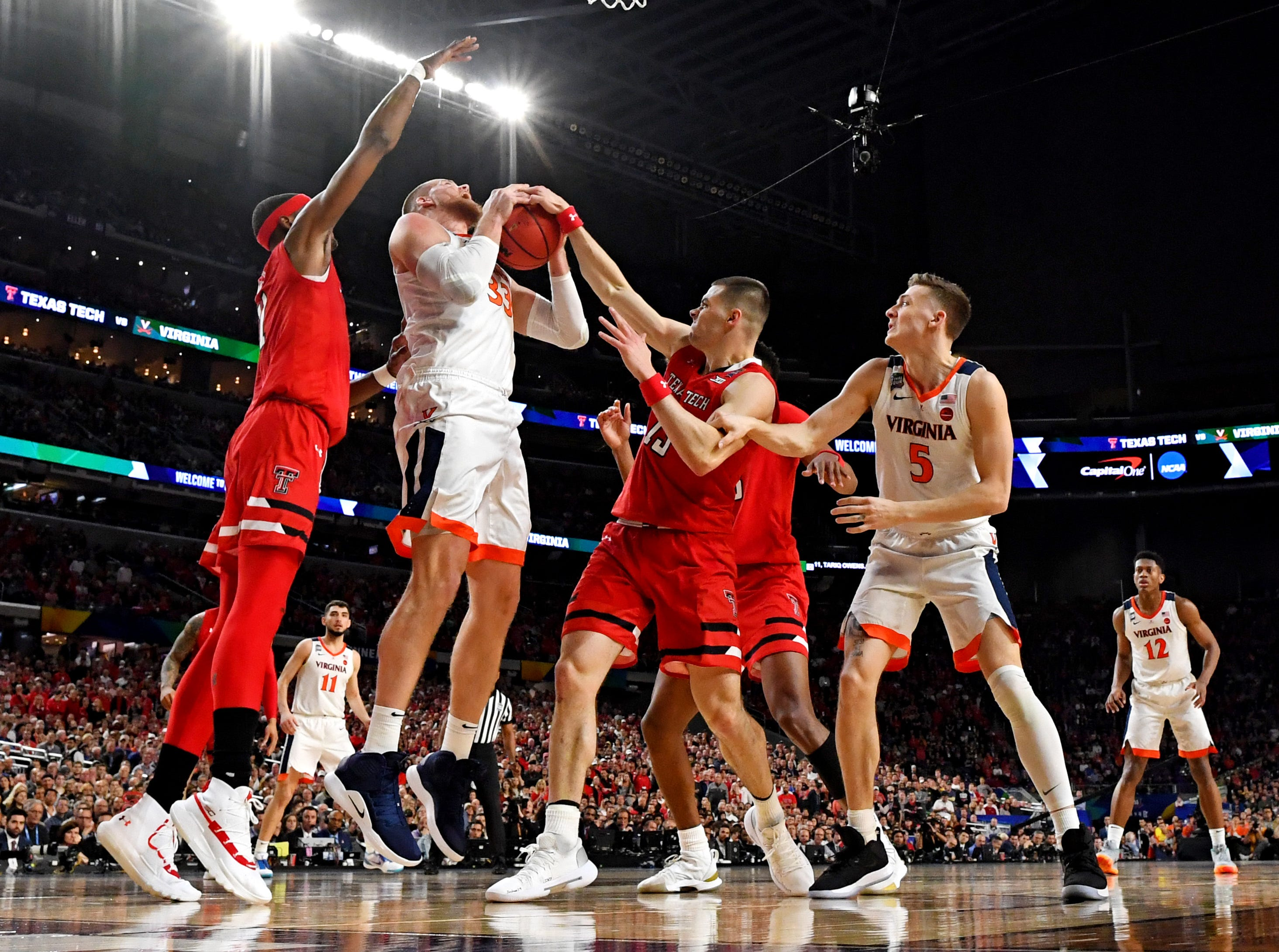 Apr 8, 2019; Minneapolis, MN, USA; Texas Tech Red Raiders guard Matt Mooney (13) blocks a shot by Virginia Cavaliers center Jack Salt (33) during the first half in the championship game of the 2019 men's Final Four at US Bank Stadium. Mandatory Credit: Bob Donnan-USA TODAY Sports