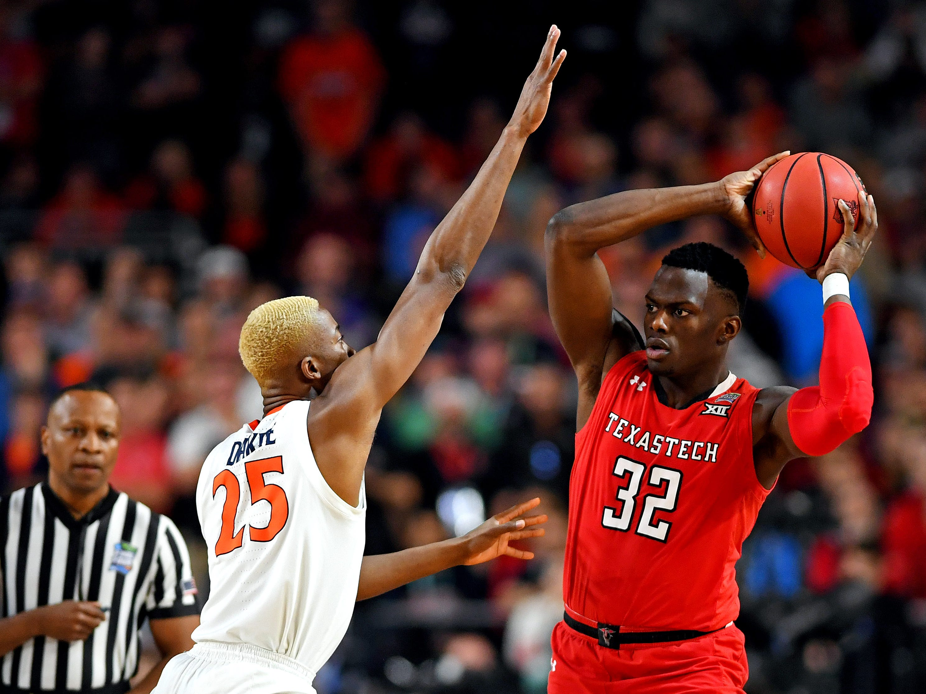 Apr 8, 2019; Minneapolis, MN, USA; Texas Tech Red Raiders center Norense Odiase (32) handles the ball against Virginia Cavaliers forward Mamadi Diakite (25) during the first half in the championship game of the 2019 men's Final Four at US Bank Stadium. Mandatory Credit: Bob Donnan-USA TODAY Sports