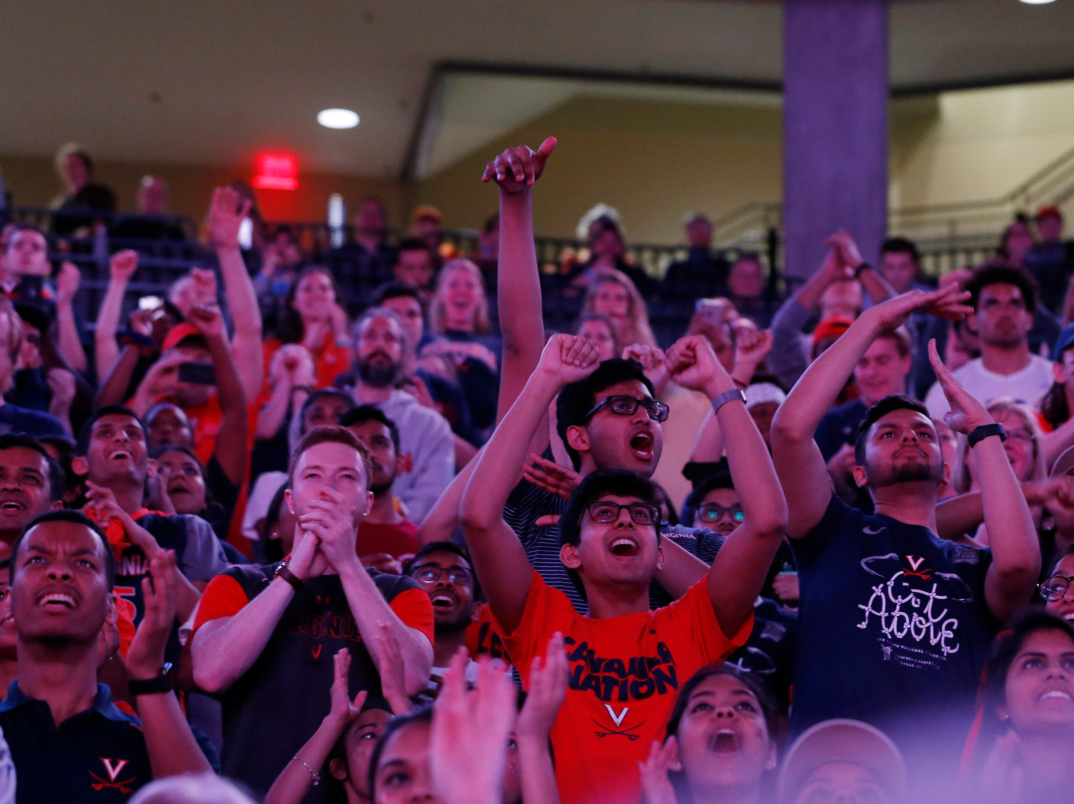 Apr 8, 2019; Charlottesville, VA, USA; Fans react during a viewing party at John Paul Jones Arena for the the championship game of the 2019 men's Final Four between the Texas Tech Red Raiders and the Virginia Cavaliers. Mandatory Credit: Geoff Burke-USA TODAY Sports