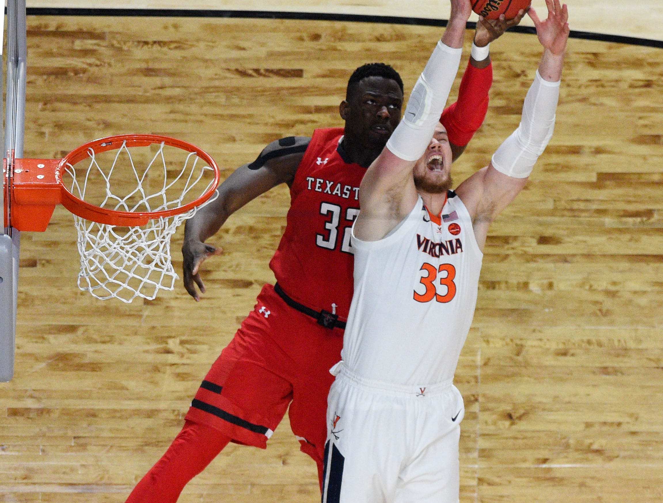Apr 8, 2019; Minneapolis, MN, USA; Virginia Cavaliers center Jack Salt (33) battles for the ball with Texas Tech Red Raiders center Norense Odiase (32) in the first half in the championship game of the 2019 men's Final Four at US Bank Stadium. Mandatory Credit: Robert Deutsch-USA TODAY Sports