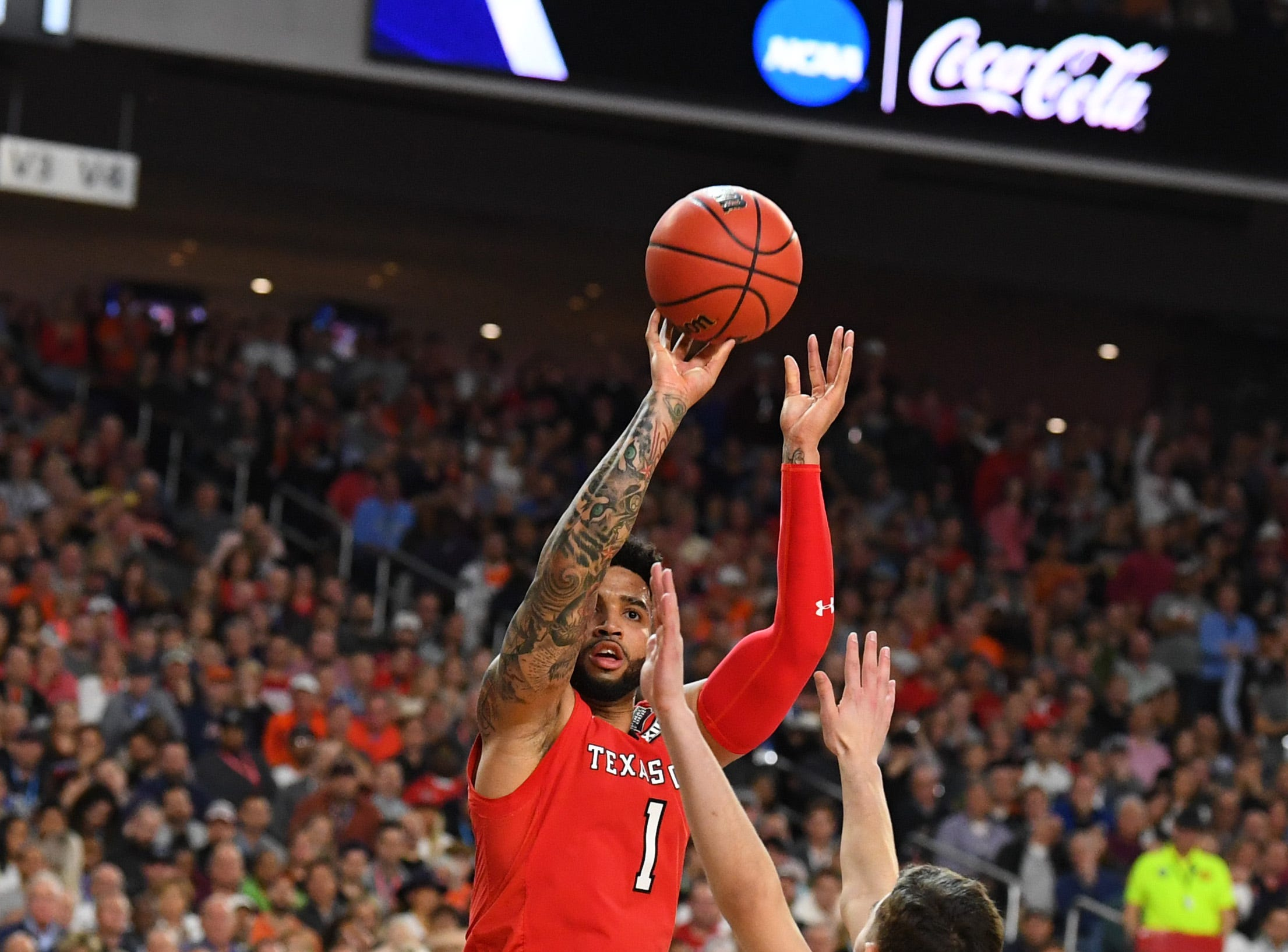 Apr 8, 2019; Minneapolis, MN, USA; Texas Tech Red Raiders guard Brandone Francis (1) shoots the ball over Virginia Cavaliers guard Ty Jerome (11) in the championship game of the 2019 men's Final Four at US Bank Stadium. Mandatory Credit: Robert Deutsch-USA TODAY Sports