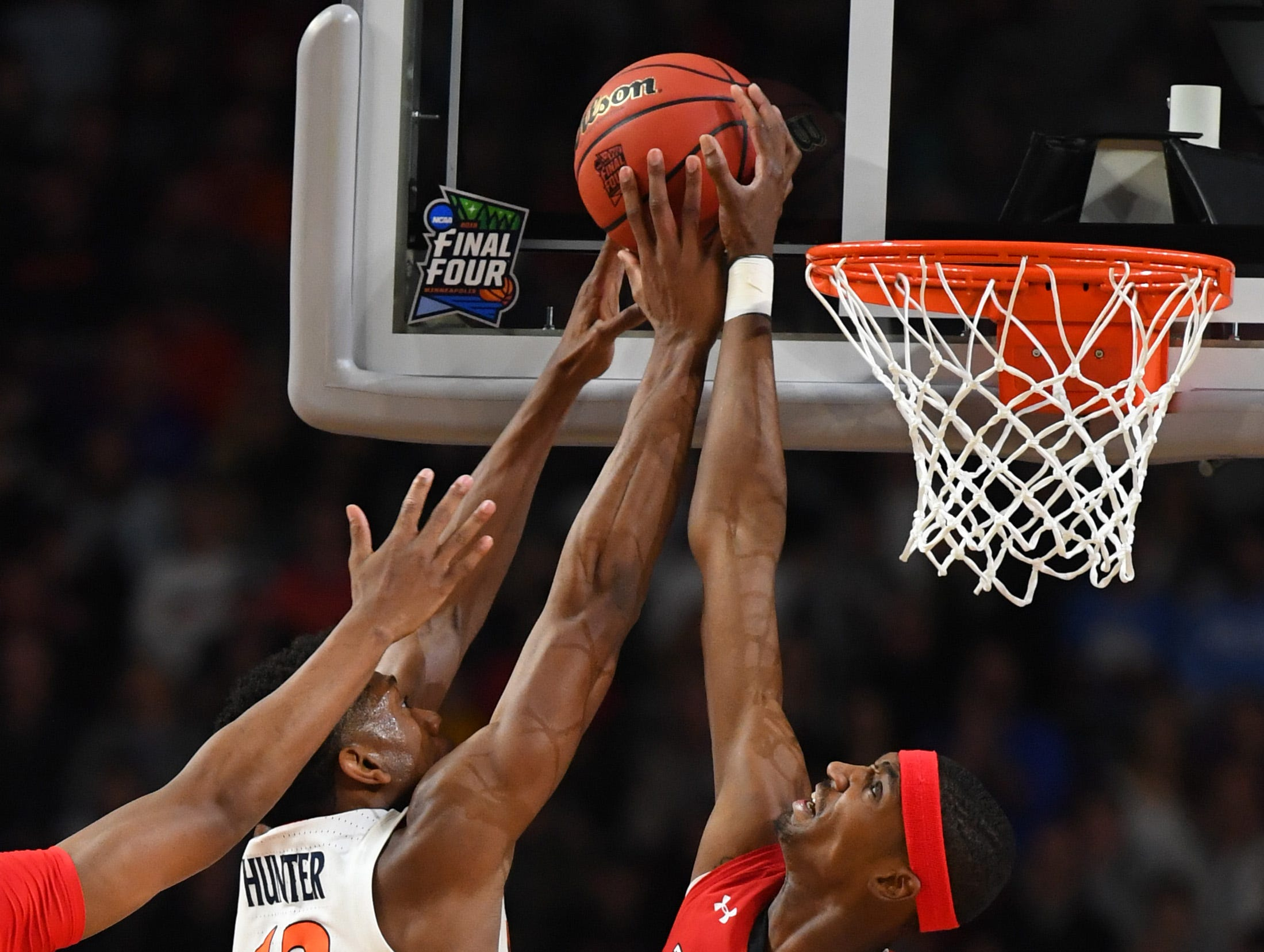 Apr 8, 2019; Minneapolis, MN, USA; Texas Tech Red Raiders forward Tariq Owens (11) blocks the shot of Virginia Cavaliers guard De'Andre Hunter (12) in the championship game of the 2019 men's Final Four at US Bank Stadium. Mandatory Credit: Robert Deutsch-USA TODAY Sports