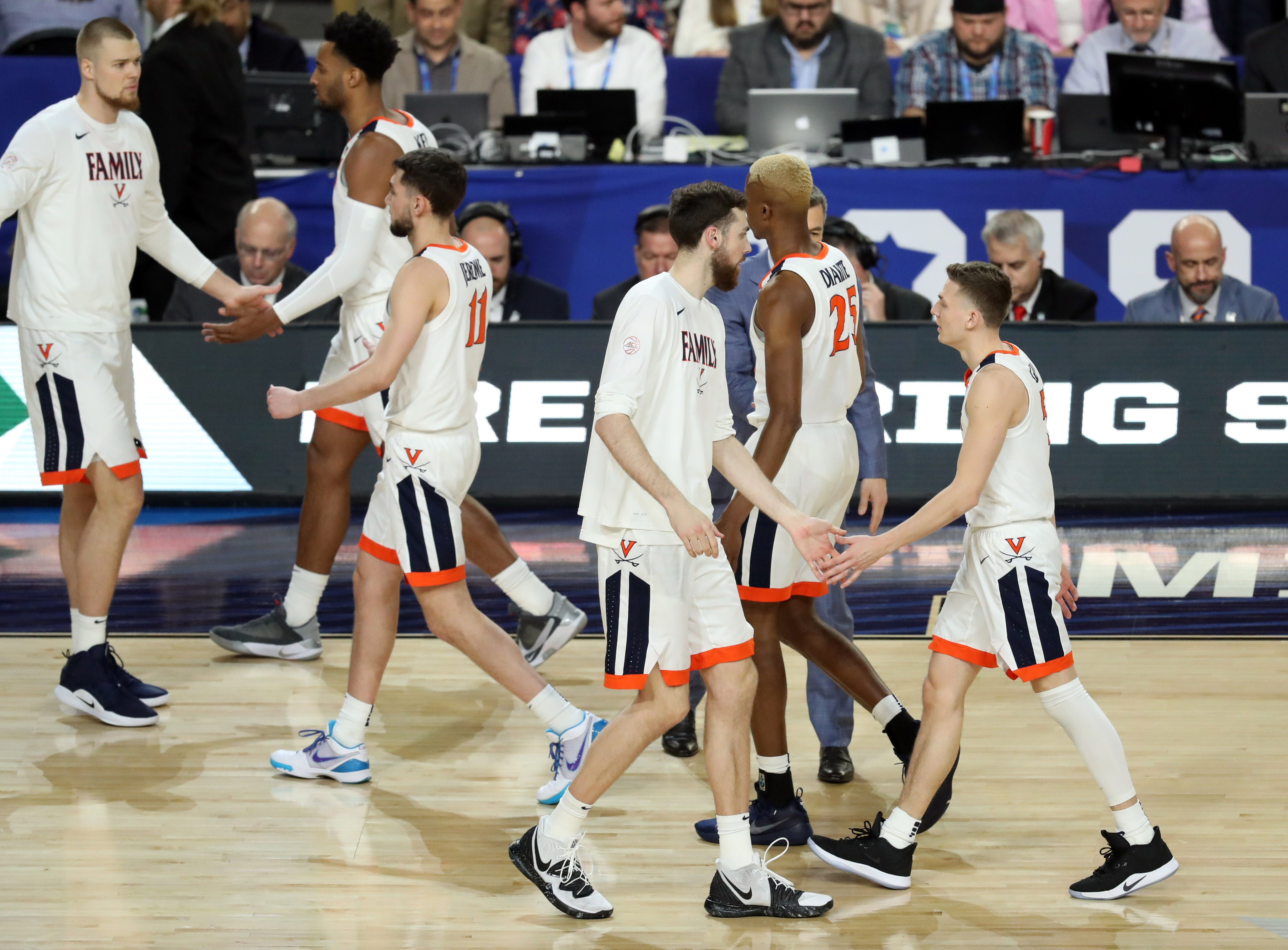 Apr 8, 2019; Minneapolis, MN, USA; The Virginia Cavaliers during a timeout in the first half against the Texas Tech Red Raiders in the championship game of the 2019 men's Final Four at US Bank Stadium. Mandatory Credit: Brace Hemmelgarn-USA TODAY Sports
