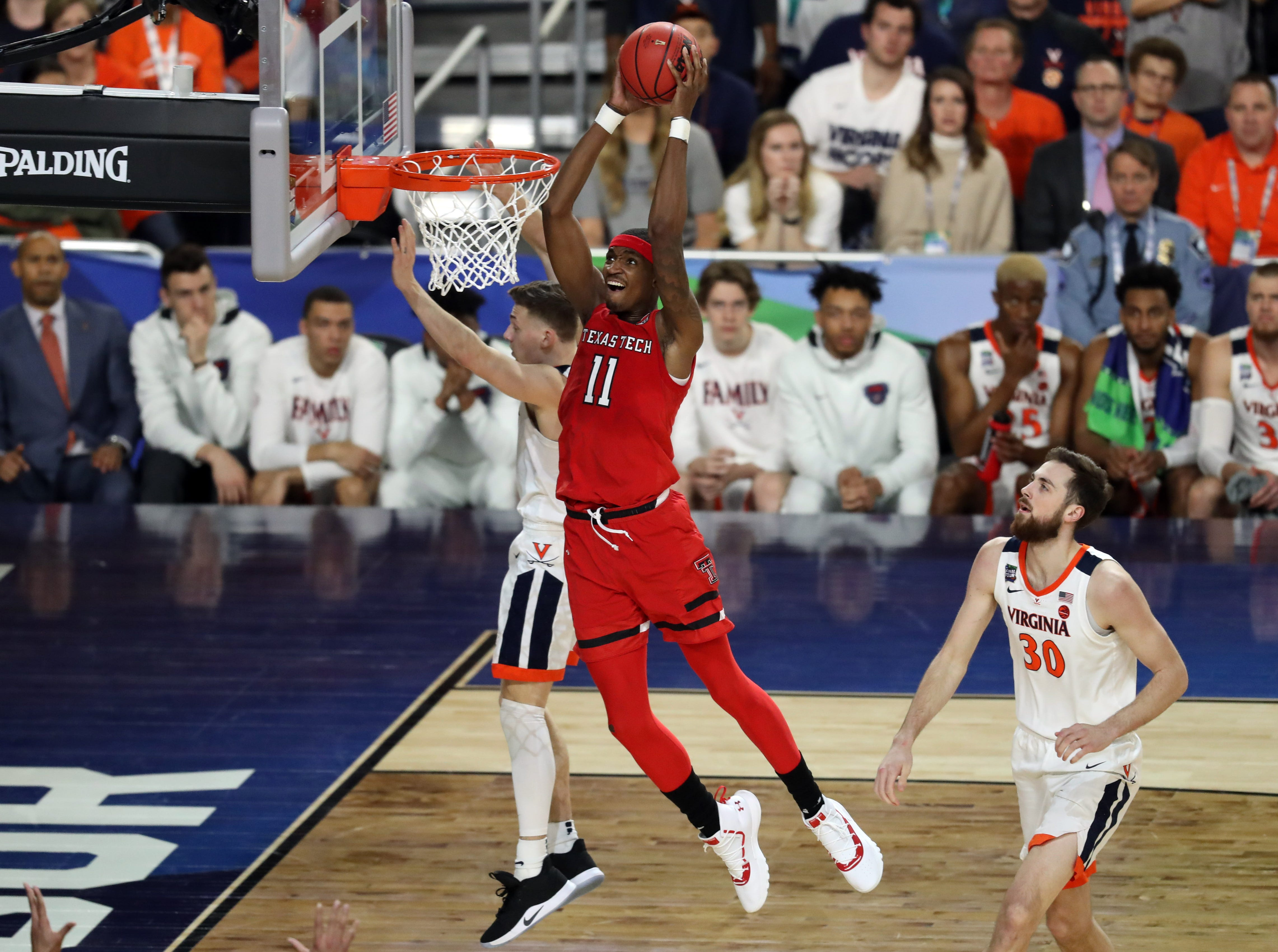 Apr 8, 2019; Minneapolis, MN, USA; Texas Tech Red Raiders forward Tariq Owens (11) dunks the ball during the first half against the Virginia Cavaliers in the championship game of the 2019 men's Final Four at US Bank Stadium. Mandatory Credit: Brace Hemmelgarn-USA TODAY Sports