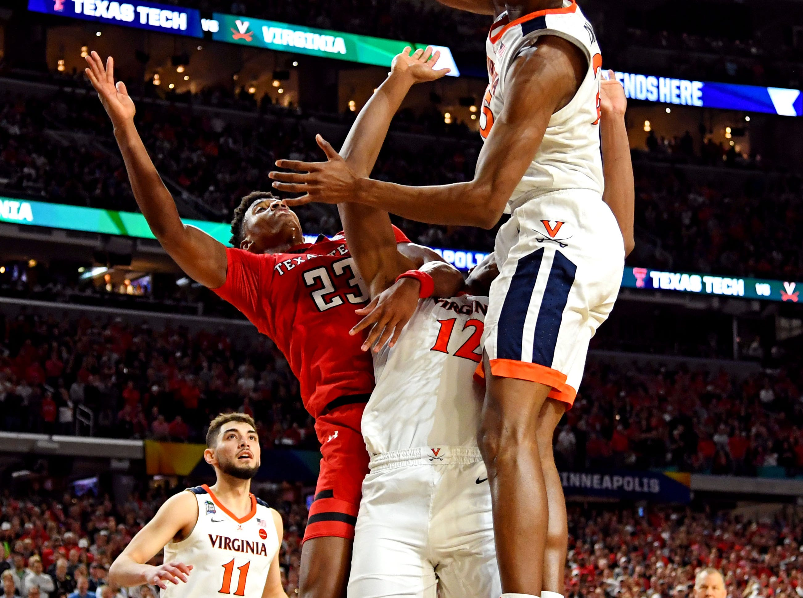 Apr 8, 2019; Minneapolis, MN, USA; Virginia Cavaliers forward Mamadi Diakite (25) blocks the shots of Texas Tech Red Raiders guard Jarrett Culver (23) during overtime in the championship game of the 2019 men's Final Four at US Bank Stadium. Mandatory Credit: Bob Donnan-USA TODAY Sports