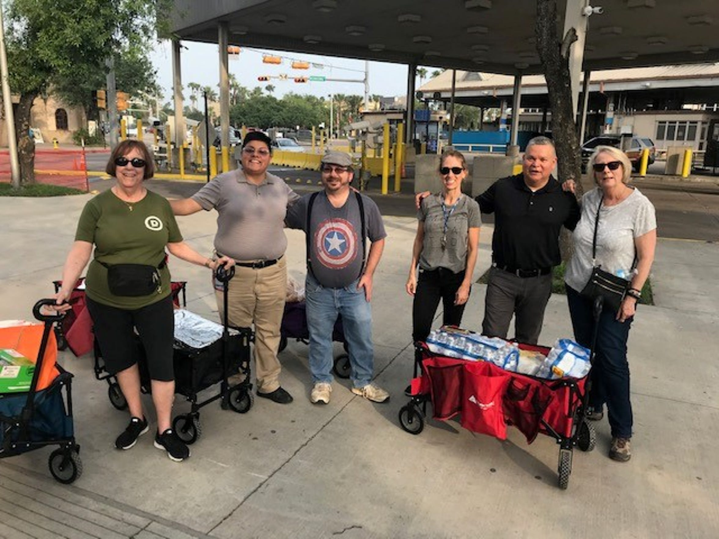 From left: Anne Rioux, Christina Escobedo, Emmett Blake, Diane Beckman, Mike Benavides and Ann Finch at the bus station in Brownsville, Texas, prepare to bring meals to asylum seekers in Matamoros, Mexico, on April 4, 2018.