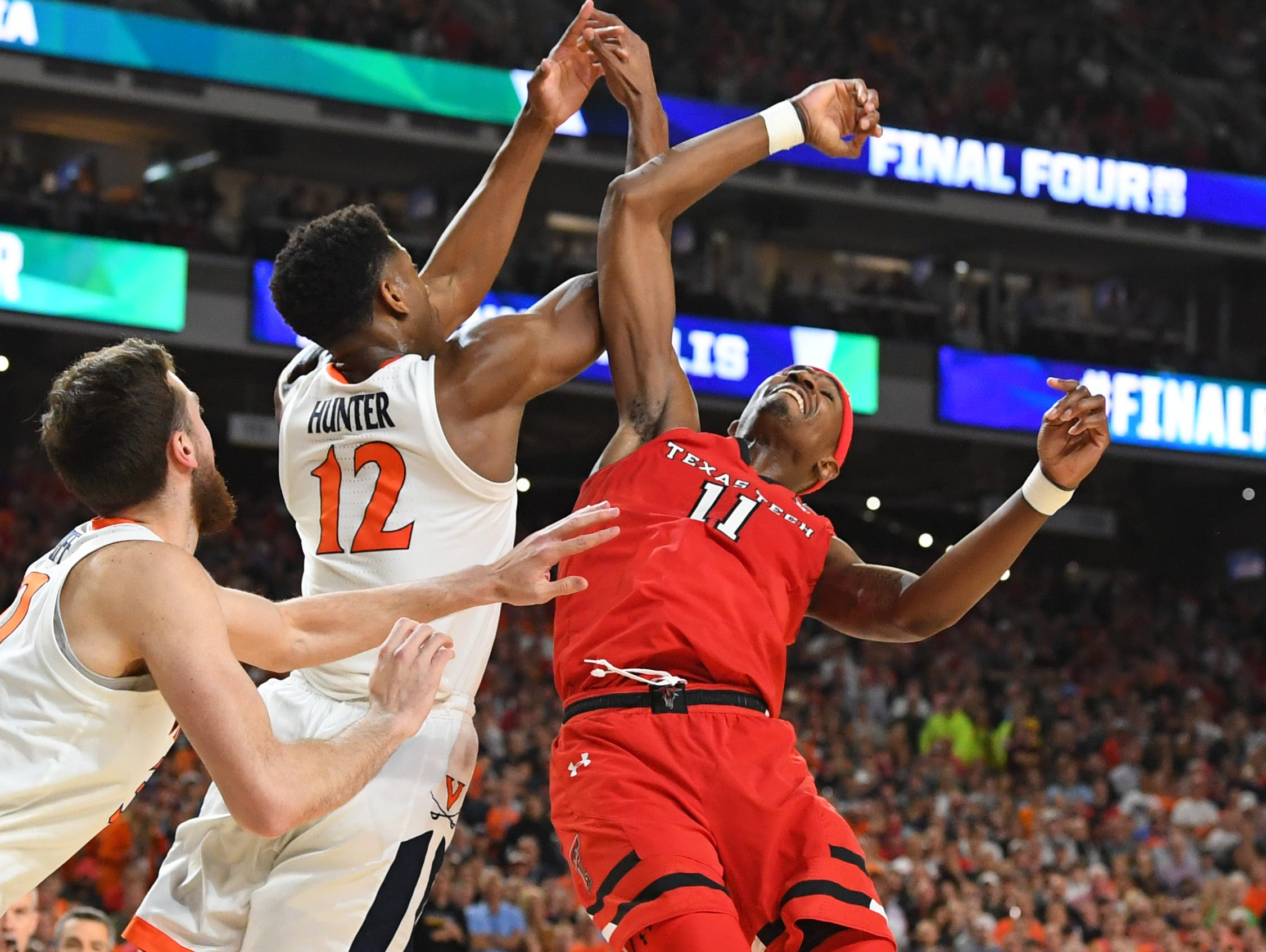Apr 8, 2019; Minneapolis, MN, USA; Virginia Cavaliers guard De'Andre Hunter (12) and Texas Tech Red Raiders forward Tariq Owens (11) battle for a loose ball in the championship game of the 2019 men's Final Four at US Bank Stadium. Mandatory Credit: Robert Deutsch-USA TODAY Sports