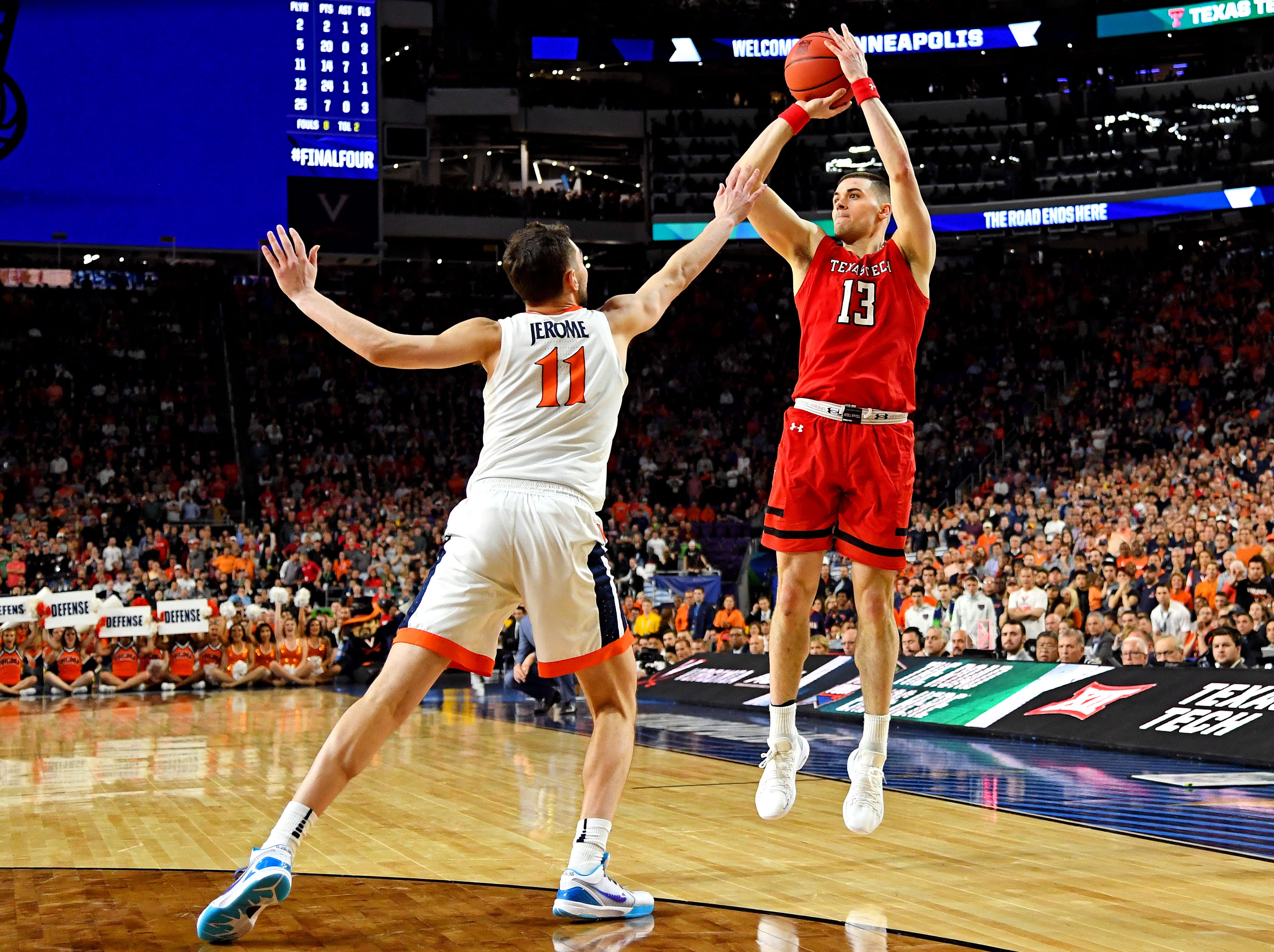 Apr 8, 2019; Minneapolis, MN, USA; Texas Tech Red Raiders guard Matt Mooney (13) shoots the ball against Virginia Cavaliers guard Ty Jerome (11) during overtime in the championship game of the 2019 men's Final Four at US Bank Stadium. Mandatory Credit: Bob Donnan-USA TODAY Sports