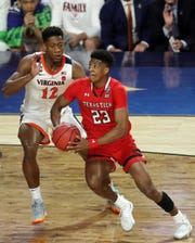 Apr 8, 2019; Minneapolis, MN, USA; Texas Tech Red Raiders guard Jarrett Culver (23) drives around Virginia Cavaliers guard De'Andre Hunter (12) during the first half in the championship game of the 2019 men's Final Four at US Bank Stadium. Mandatory Credit: Brace Hemmelgarn-USA TODAY Sports