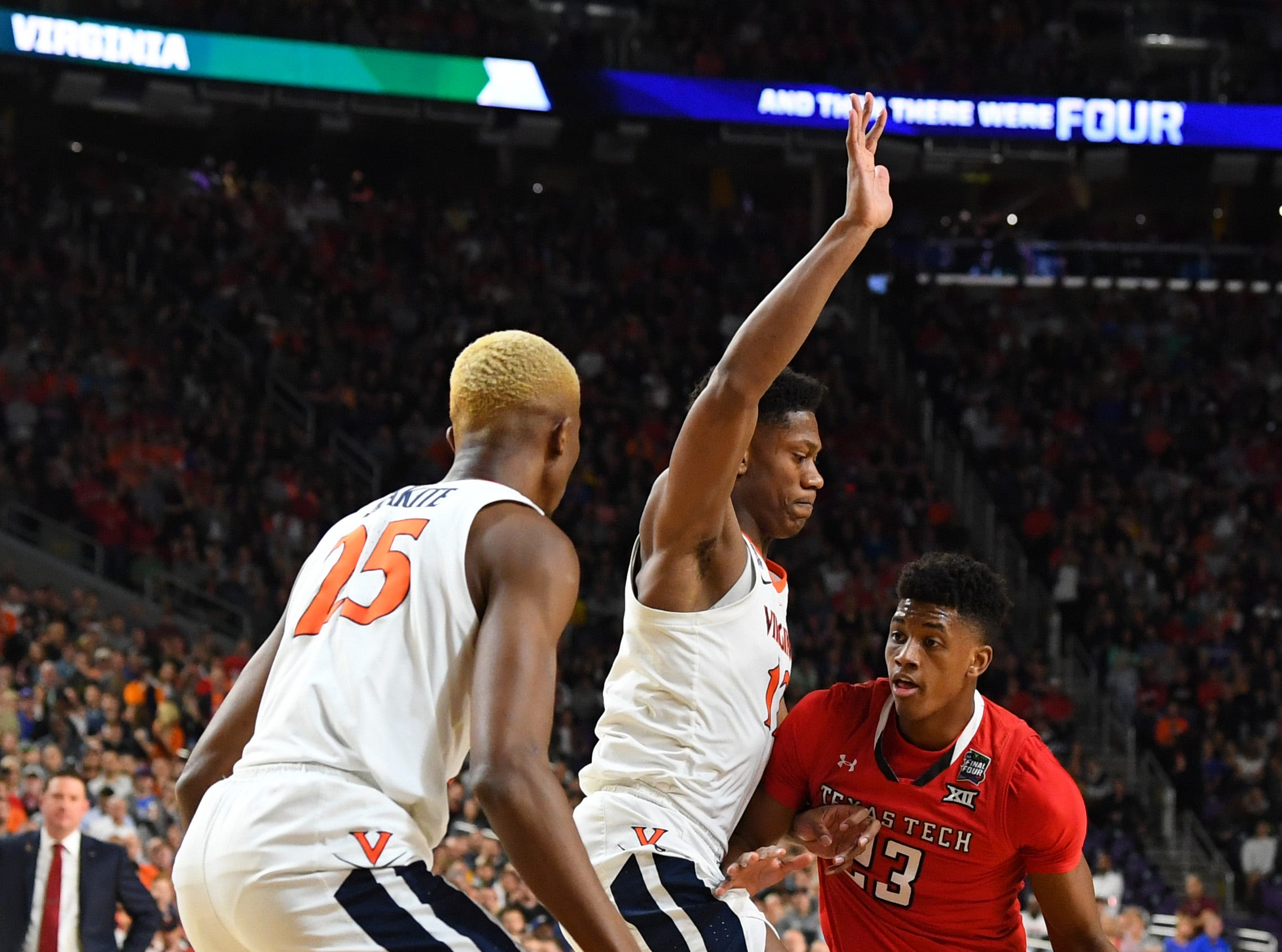 Apr 8, 2019; Minneapolis, MN, USA; Texas Tech Red Raiders guard Jarrett Culver (23) drives to the basket defended by Virginia Cavaliers guard De'Andre Hunter (12) and forward Mamadi Diakite (25) in the championship game of the 2019 men's Final Four at US Bank Stadium. Mandatory Credit: Robert Deutsch-USA TODAY Sports