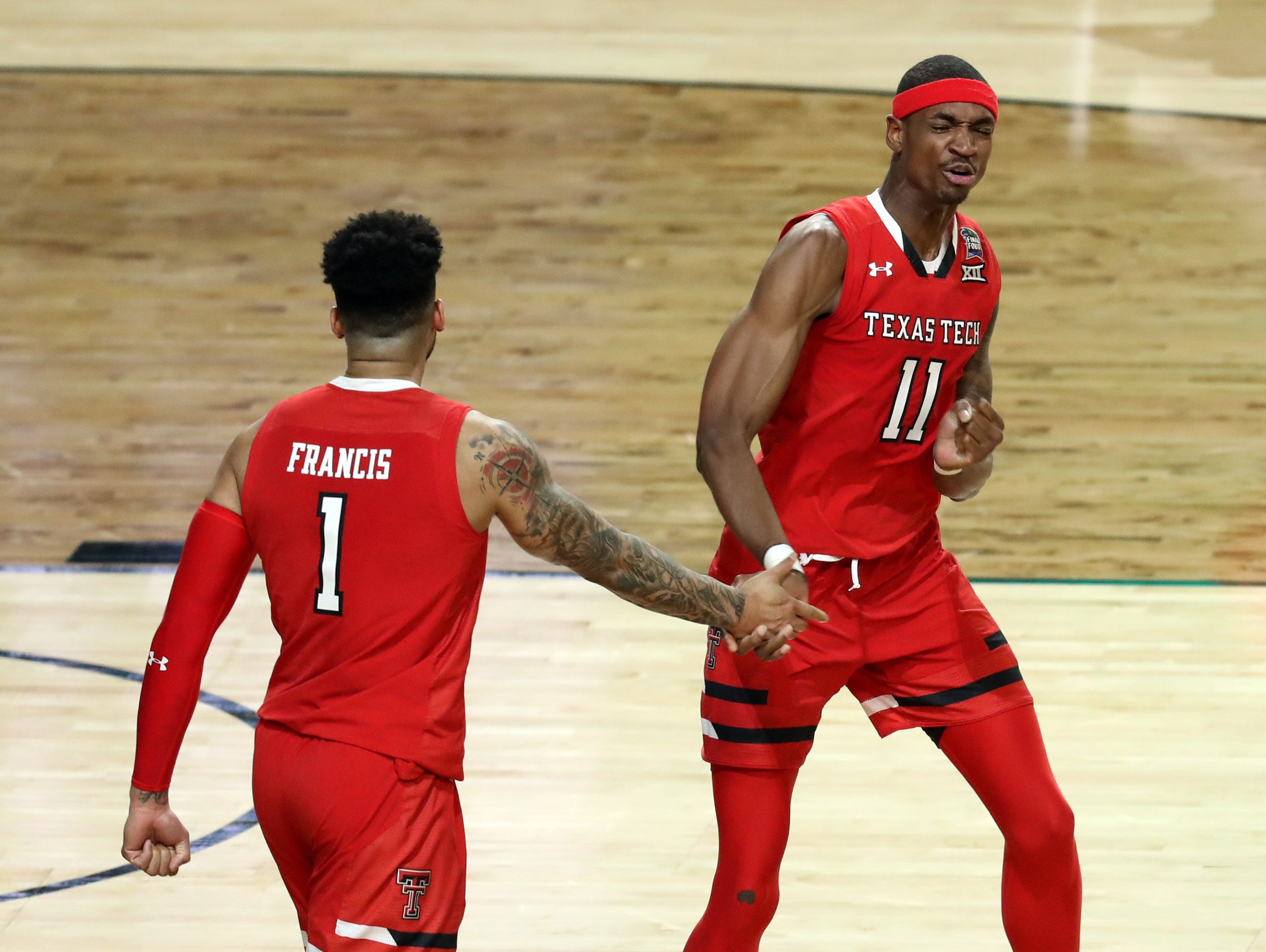 Apr 8, 2019; Minneapolis, MN, USA; Texas Tech Red Raiders forward Tariq Owens (11) celebrates with  uard Brandone Francis (1) after dunking the ball against the Virginia Cavaliers in the championship game of the 2019 men's Final Four at US Bank Stadium. Mandatory Credit: Brace Hemmelgarn-USA TODAY Sports
