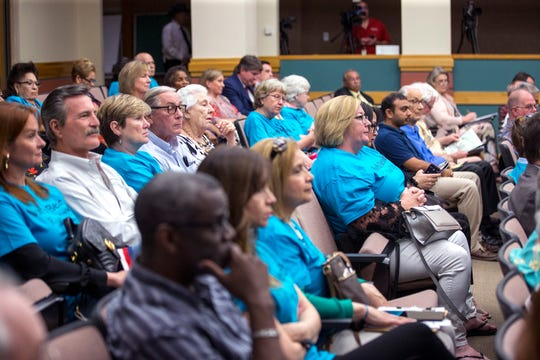 Resident of North Beach, and non-residents, wore blue shirts to show support for a recently proposed $40 million canal for North Beach during public comment at city council on Tuesday, April 9, 2019.