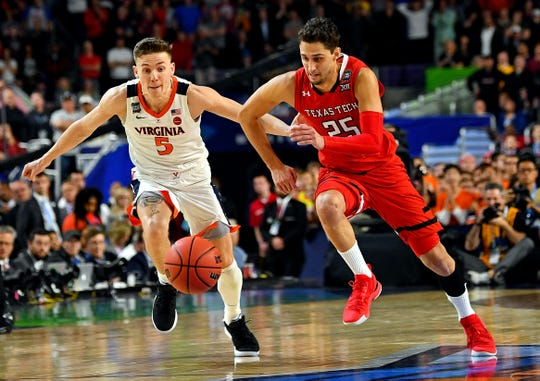 Apr 8, 2019; Minneapolis, MN, USA; Texas Tech Red Raiders guard Davide Moretti (25) and Virginia Cavaliers guard Kyle Guy (5) go for a loose ball during overtime in the championship game of the 2019 men's Final Four at US Bank Stadium. Mandatory Credit: Bob Donnan-USA TODAY Sports