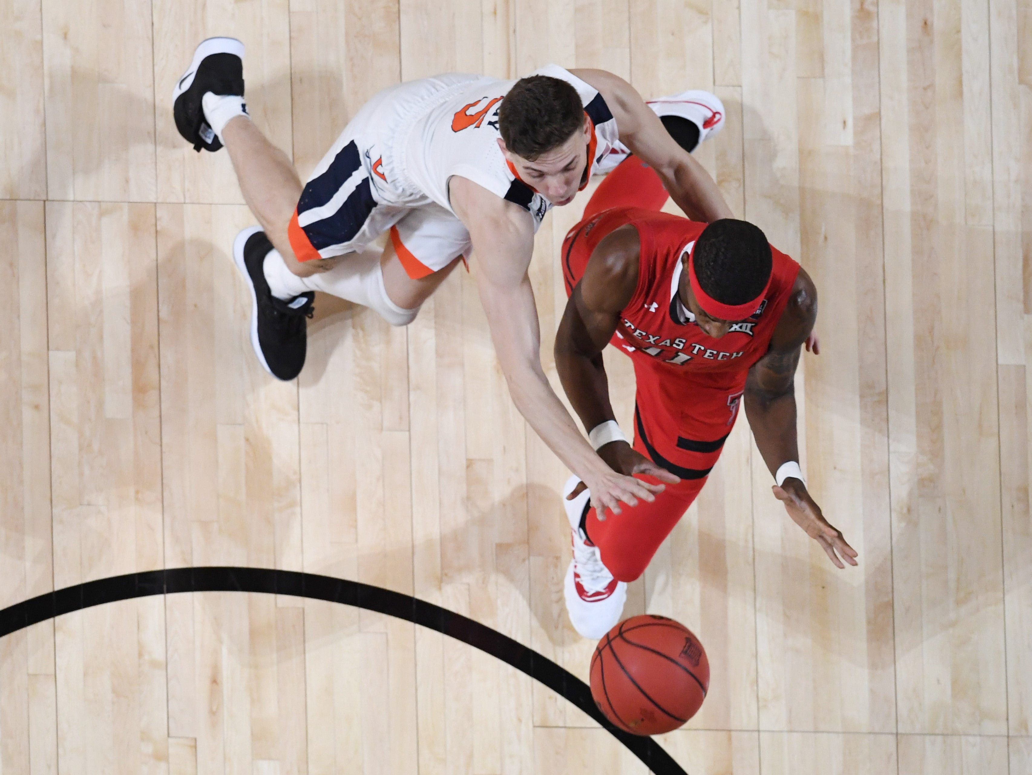 Apr 8, 2019; Minneapolis, MN, USA; Texas Tech Red Raiders forward Tariq Owens (11) battles for the ball with Virginia Cavaliers guard Kyle Guy (5) in the first half in the championship game of the 2019 men's Final Four at US Bank Stadium. Mandatory Credit: Robert Deutsch-USA TODAY Sports