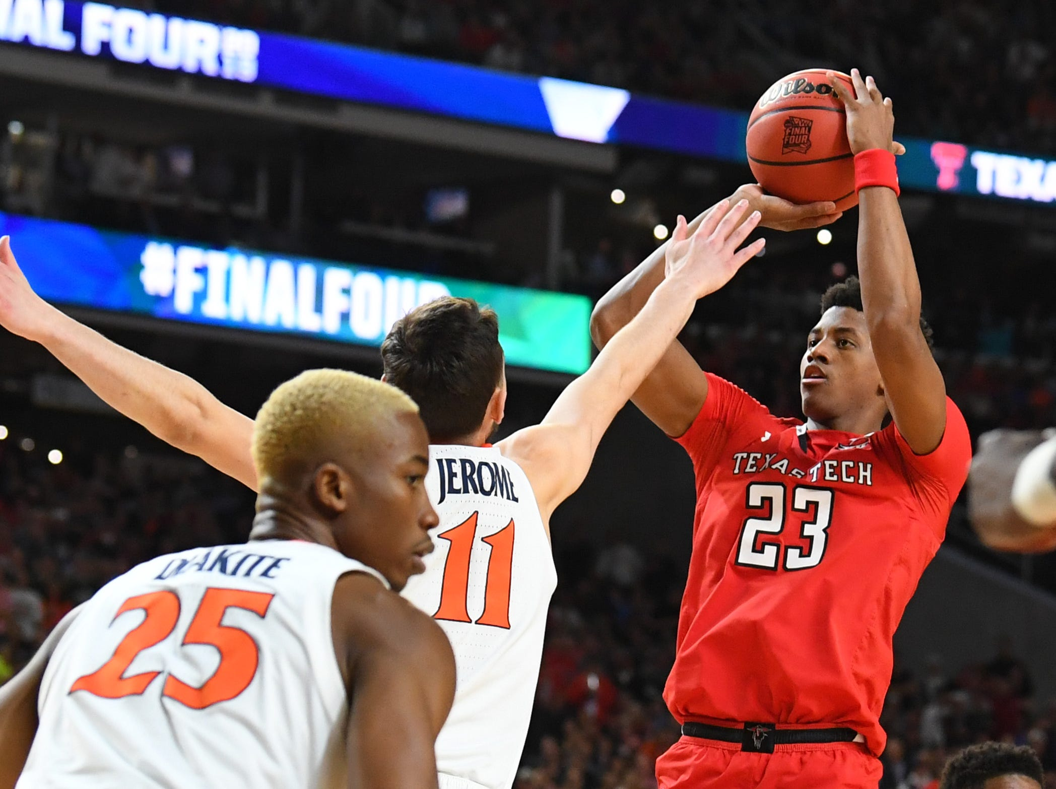 Apr 8, 2019; Minneapolis, MN, USA; Texas Tech Red Raiders guard Jarrett Culver (23) shoots the ball over Virginia Cavaliers guard Ty Jerome (11) in the championship game of the 2019 men's Final Four at US Bank Stadium. Mandatory Credit: Robert Deutsch-USA TODAY Sports