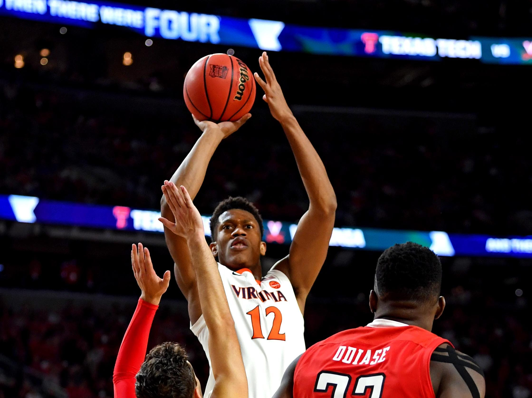 Apr 8, 2019; Minneapolis, MN, USA; Virginia Cavaliers guard De'Andre Hunter (12) shoots the ball against Texas Tech Red Raiders guard Davide Moretti (25) during the first half in the championship game of the 2019 men's Final Four at US Bank Stadium. Mandatory Credit: Bob Donnan-USA TODAY Sports