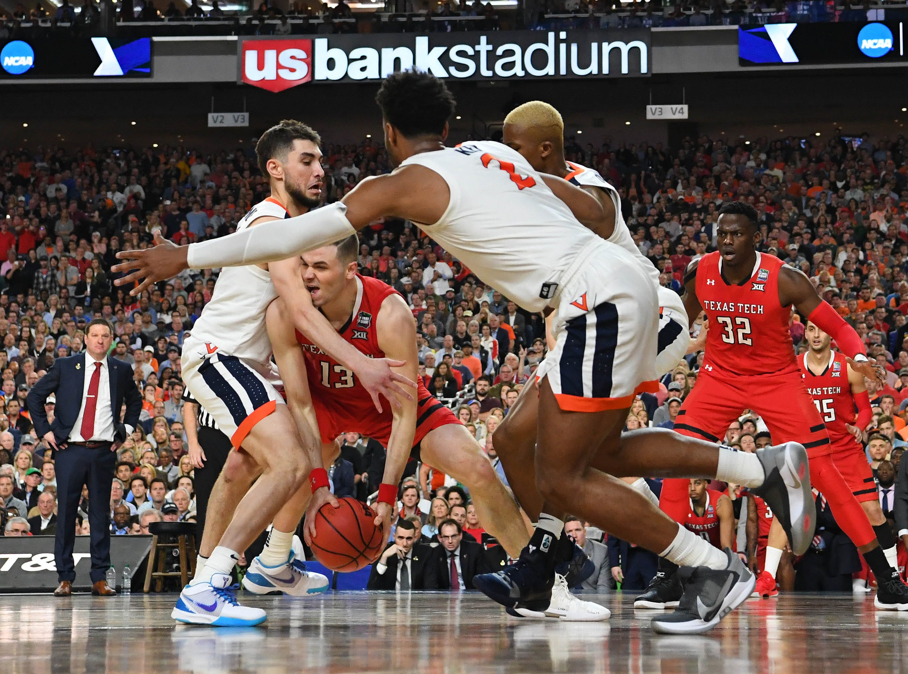 Apr 8, 2019; Minneapolis, MN, USA; Texas Tech Red Raiders guard Matt Mooney (13) looks to pass as Virginia Cavaliers guard Ty Jerome (left) and guard Braxton Key (2) defend during the second half in the championship game of the 2019 men's Final Four at US Bank Stadium. Mandatory Credit: Bob Donnan-USA TODAY Sports