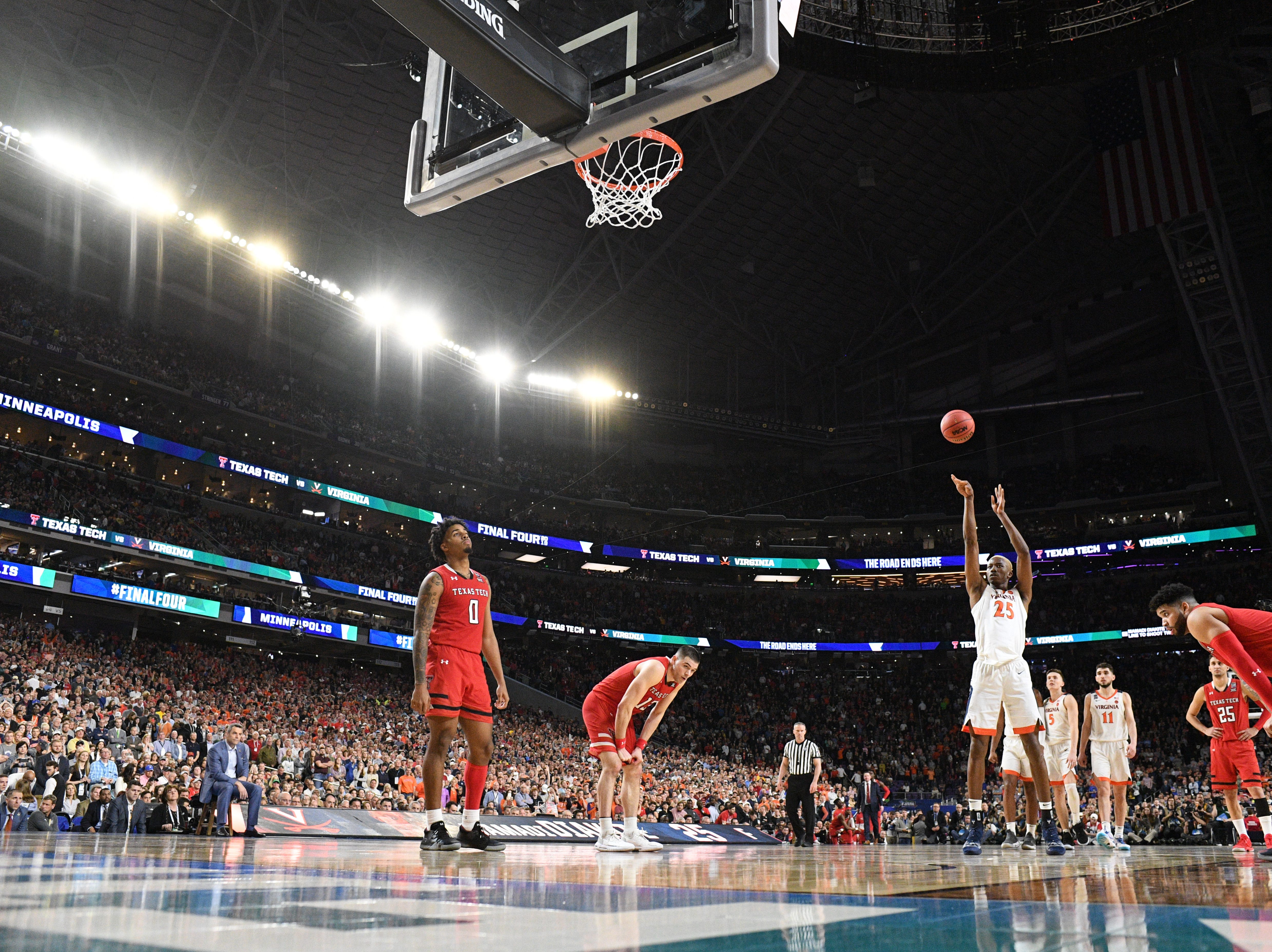 Apr 8, 2019; Minneapolis, MN, USA; Virginia Cavaliers forward Mamadi Diakite (25) hits late a late free throw in overtime against the Texas Tech Red Raiders in the championship game of the 2019 men's Final Four at US Bank Stadium. Mandatory Credit: Robert Deutsch-USA TODAY Sports