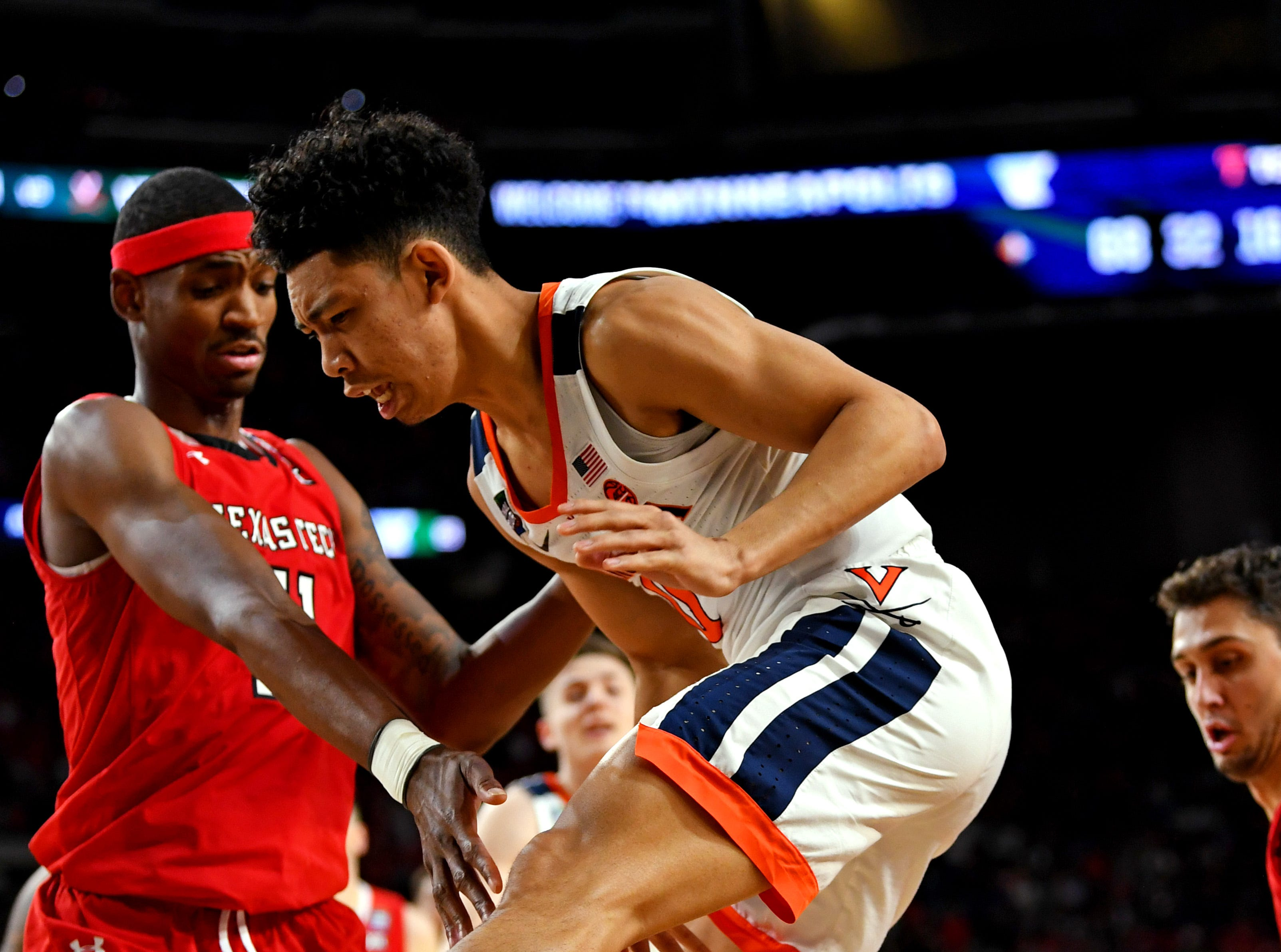 Apr 8, 2019; Minneapolis, MN, USA; Texas Tech Red Raiders forward Tariq Owens (11) knocks the ball away from Virginia Cavaliers guard Kihei Clark (0) \1h\ in the championship game of the 2019 men's Final Four at US Bank Stadium. Mandatory Credit: Bob Donnan-USA TODAY Sports