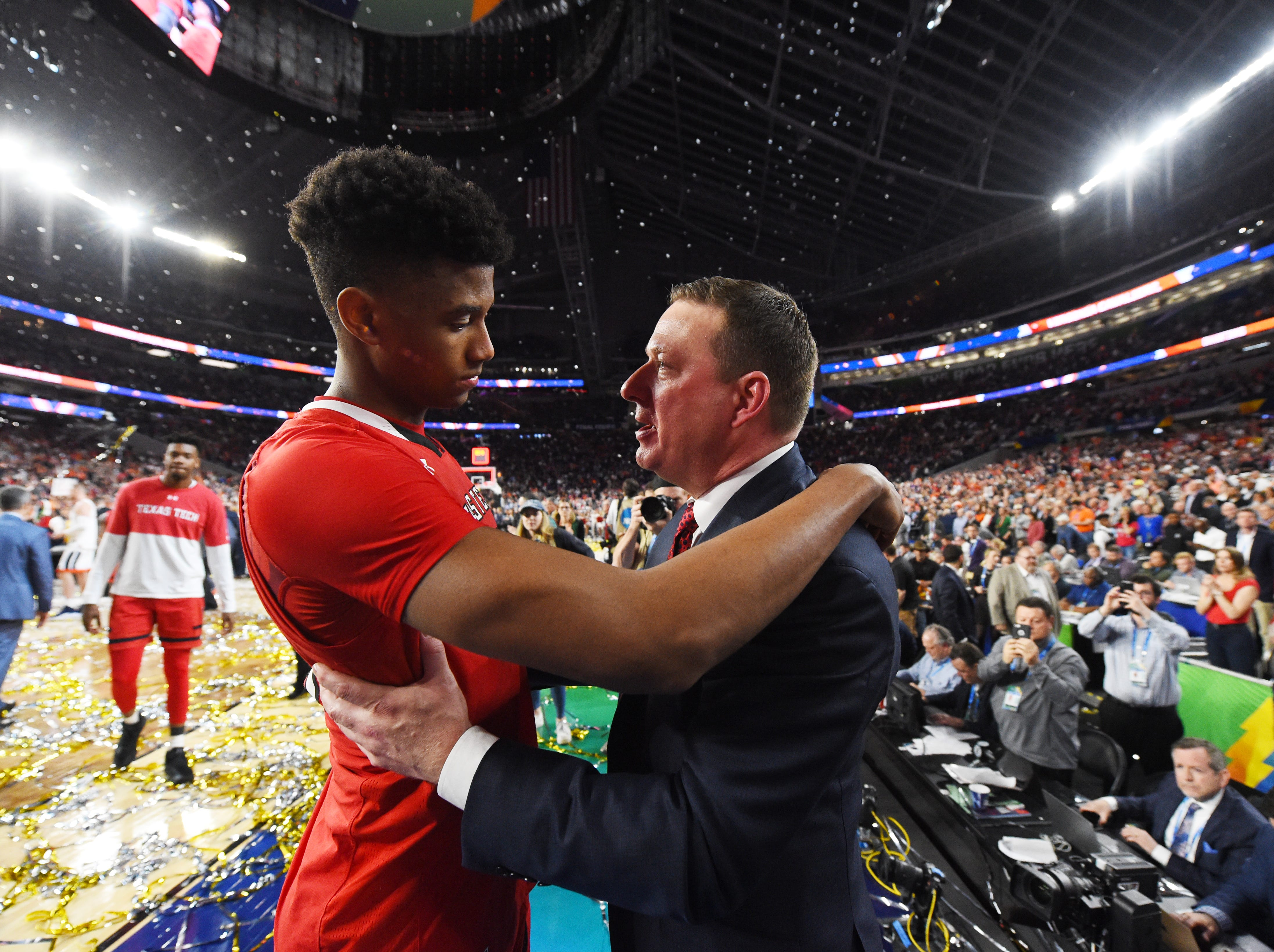 Apr 8, 2019; Minneapolis, MN, USA; Texas Tech Red Raiders head coach Chris Beard consoles guard Jarrett Culver (23) after losing to the Virginia Cavaliers in the championship game of the 2019 men's Final Four at US Bank Stadium. Mandatory Credit: Robert Deutsch-USA TODAY Sports