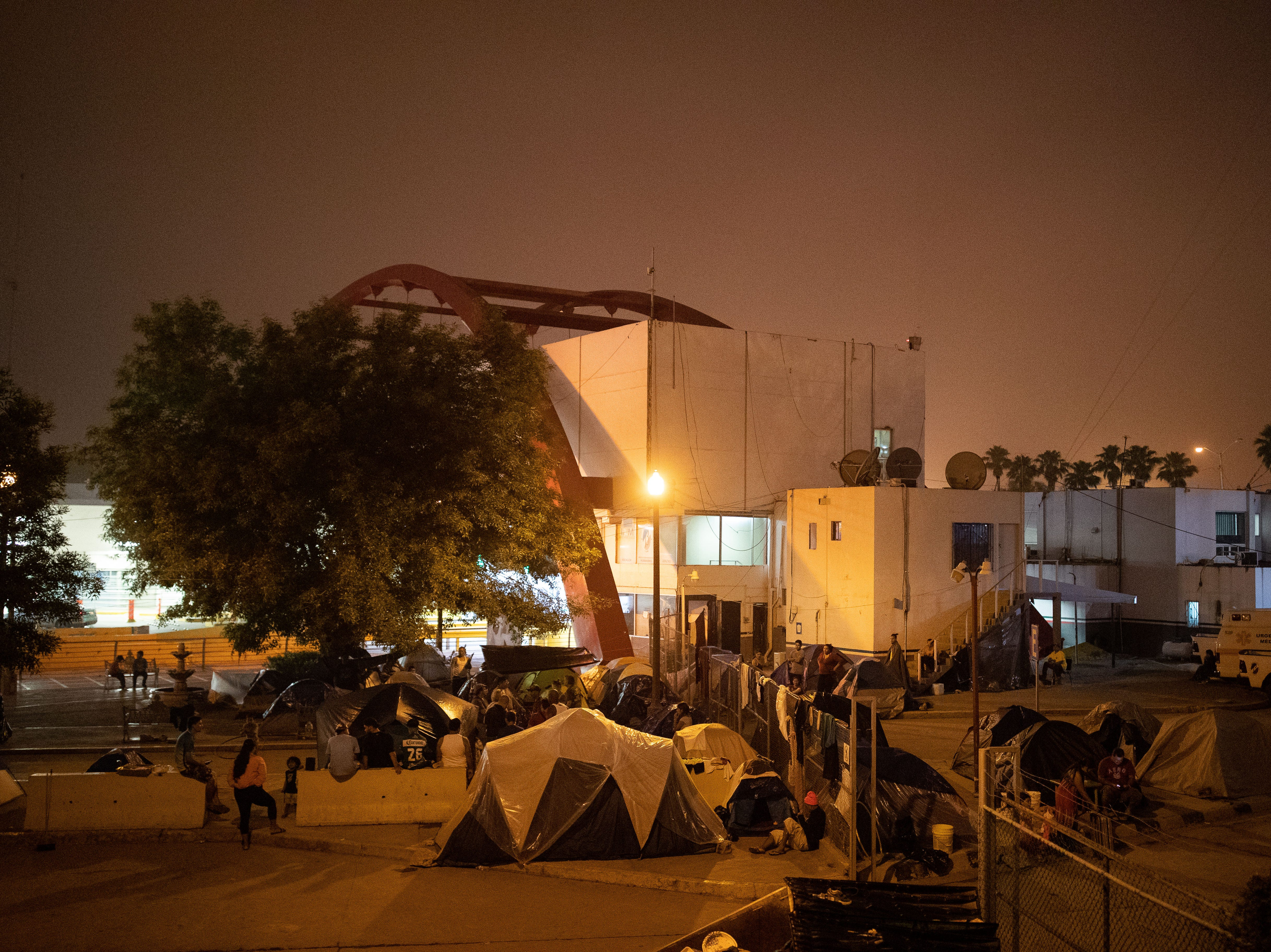 Migrants set up a makeshift camp at the base of the Gateway International Bridge in Matamoros, Mexico where migrants wait for weeks to seek asylum in the U.S on Thursday, April 4, 2019.