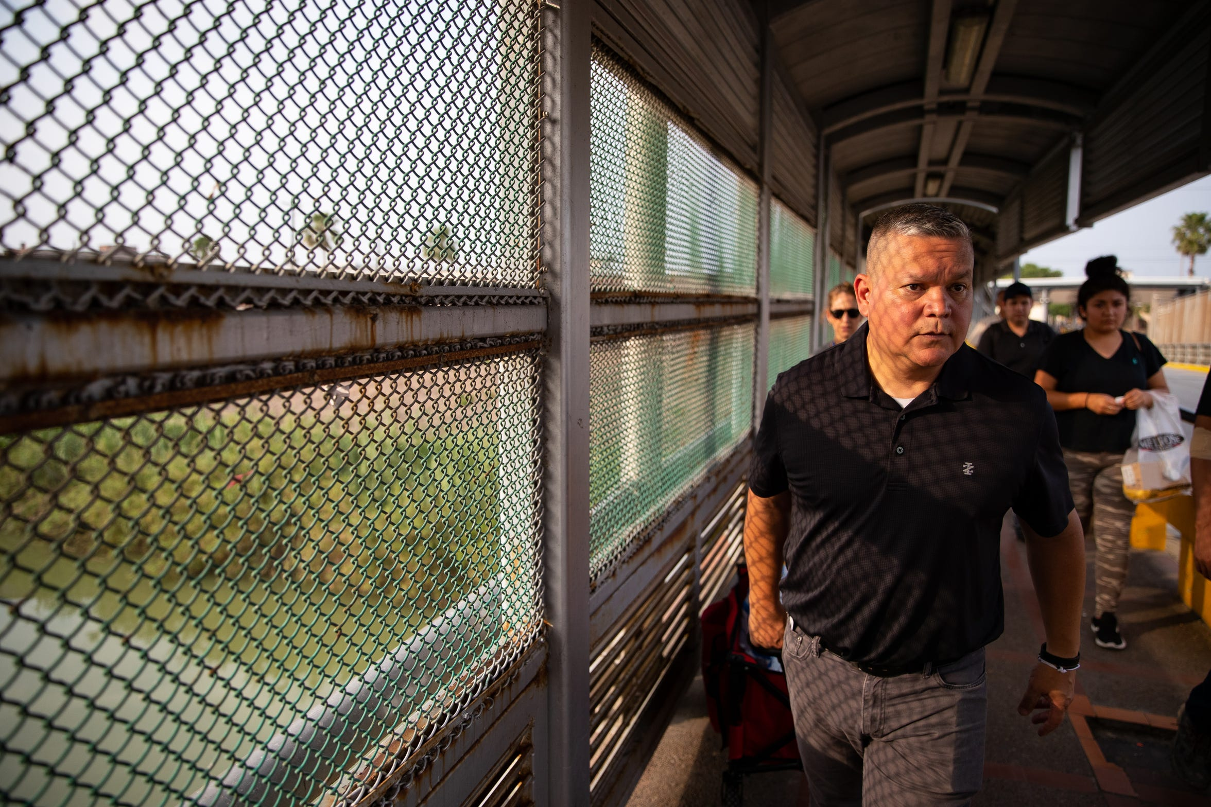 Mike Benavides, of Team Brownsville, pulls a cart full of food and supplies over the Gateway International Bridge to help migrants waiting to seek asylum camped out in a small park next to the bridge in Matamoros, Mexico on Thursday, April 4, 2019. Benavides and other volunteers bring two meals a day from the Brownsville Texas to Matamoros, Mexico to help the migrants waiting to seek asylum in the US.