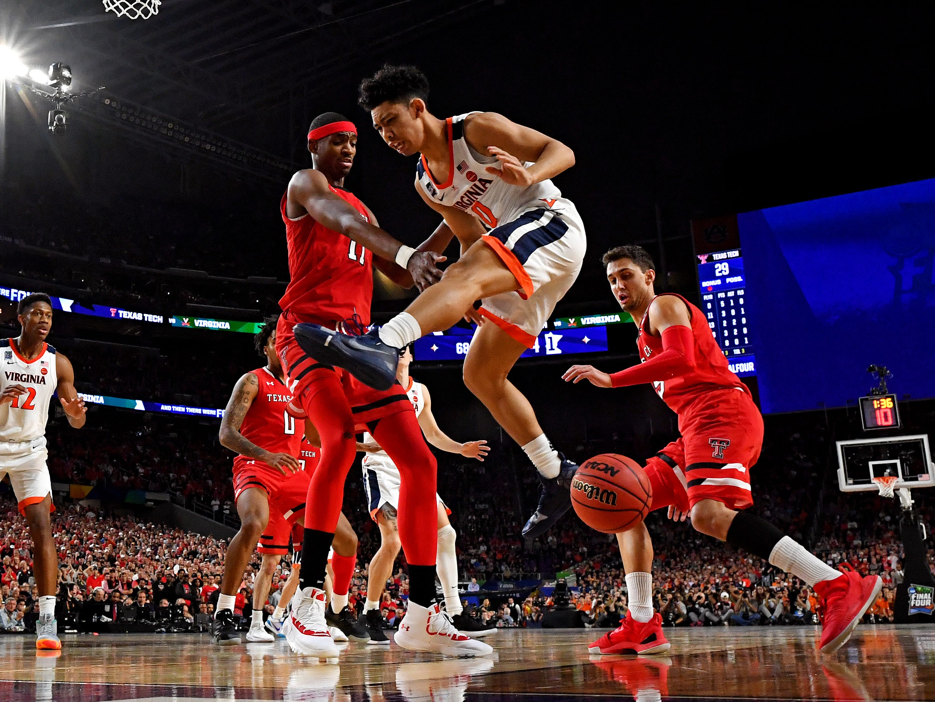Apr 8, 2019; Minneapolis, MN, USA; Texas Tech Red Raiders forward Tariq Owens (11) knocks the ball away from Virginia Cavaliers guard Kihei Clark (0) during the first half in the championship game of the 2019 men's Final Four at US Bank Stadium. Mandatory Credit: Bob Donnan-USA TODAY Sports