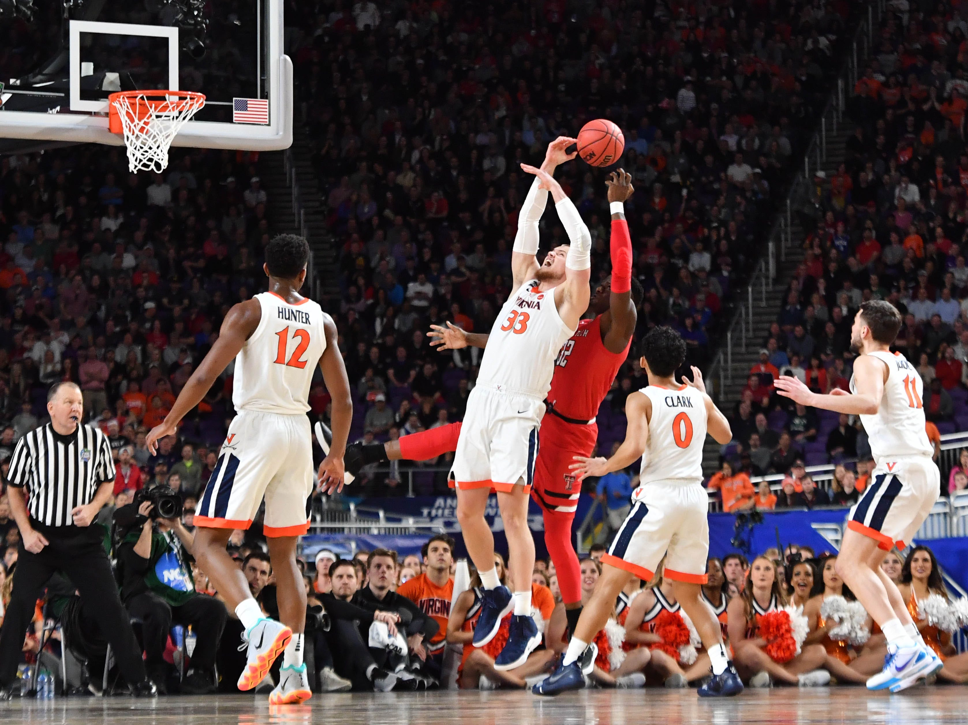Apr 8, 2019; Minneapolis, MN, USA; Virginia Cavaliers center Jack Salt (33) battles for a rebound with Texas Tech Red Raiders center Norense Odiase (32) in the first half in the championship game of the 2019 men's Final Four at US Bank Stadium. Mandatory Credit: Robert Deutsch-USA TODAY Sports
