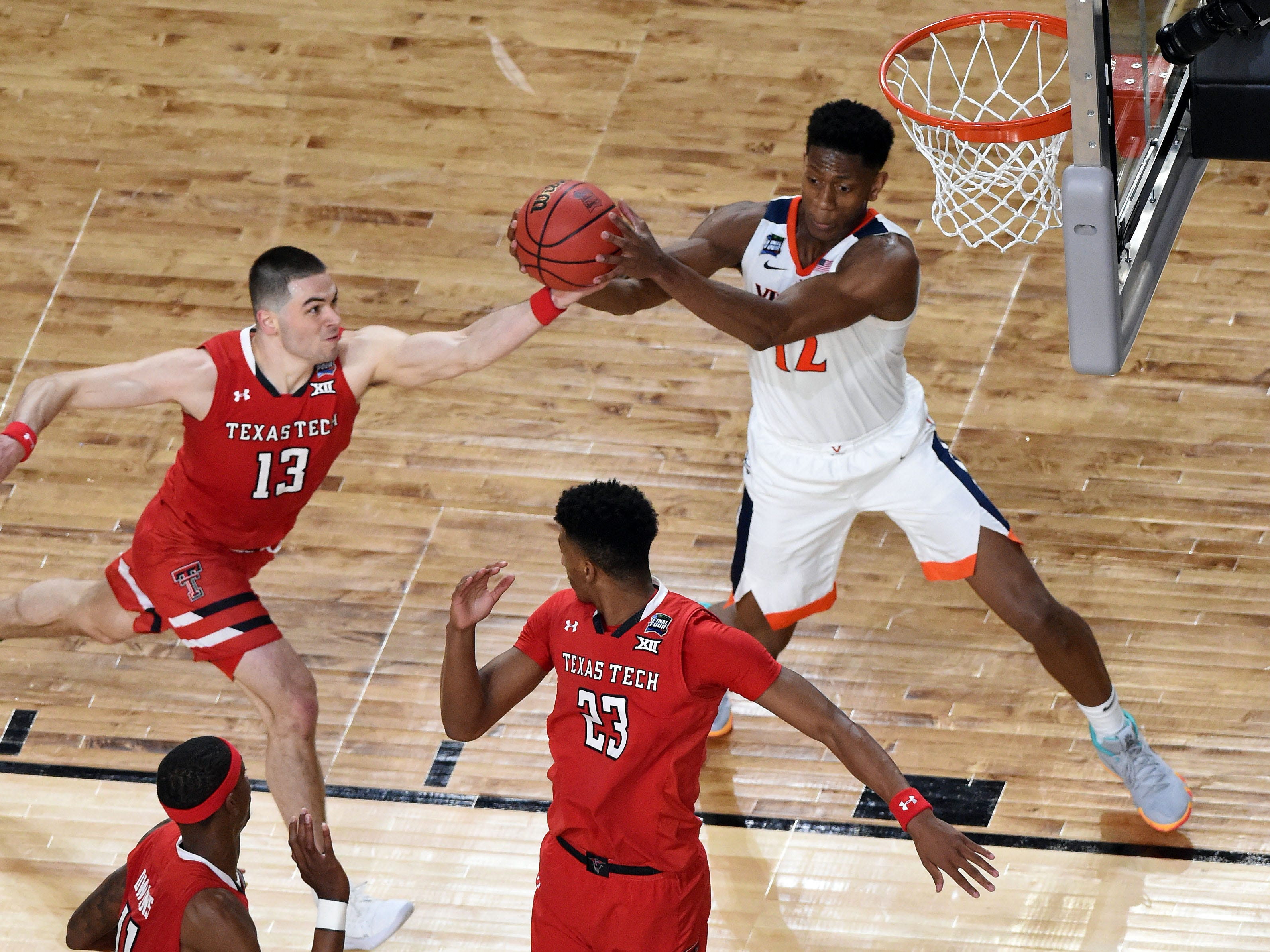 Apr 8, 2019; Minneapolis, MN, USA; Texas Tech Red Raiders guard Matt Mooney (13) defends a pass intended for Virginia Cavaliers guard De'Andre Hunter (12) during the second half in the championship game of the 2019 men's Final Four at US Bank Stadium. Mandatory Credit: Bob Donnan-USA TODAY Sports