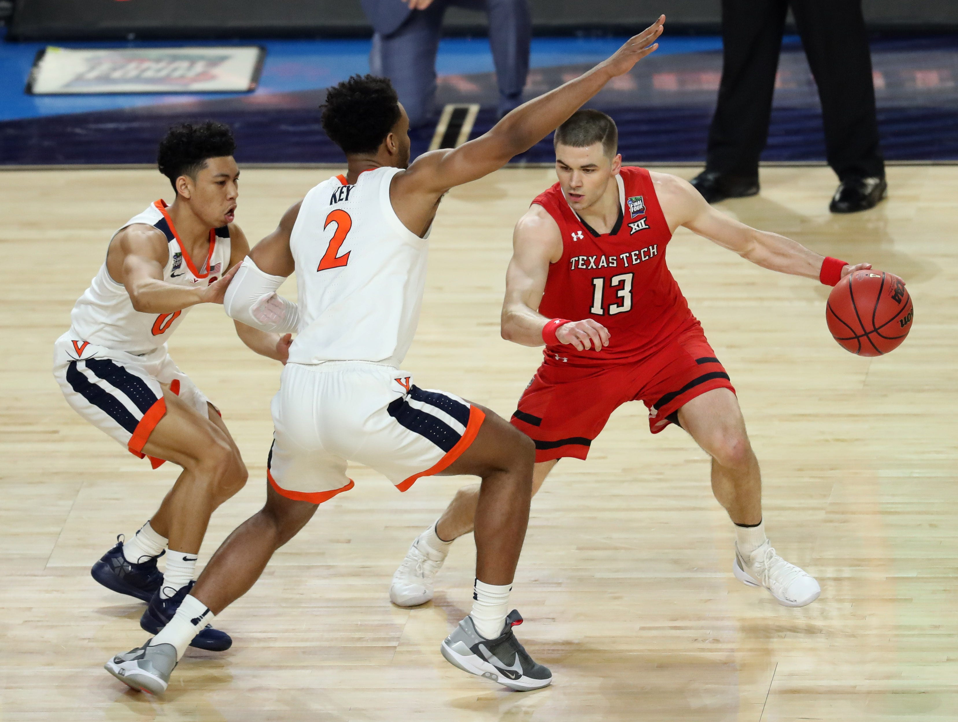Apr 8, 2019; Minneapolis, MN, USA; Texas Tech Red Raiders guard Matt Mooney (13) drives around Virginia Cavaliers guard Braxton Key (2) during the first half in the championship game of the 2019 men's Final Four at US Bank Stadium. Mandatory Credit: Brace Hemmelgarn-USA TODAY Sports