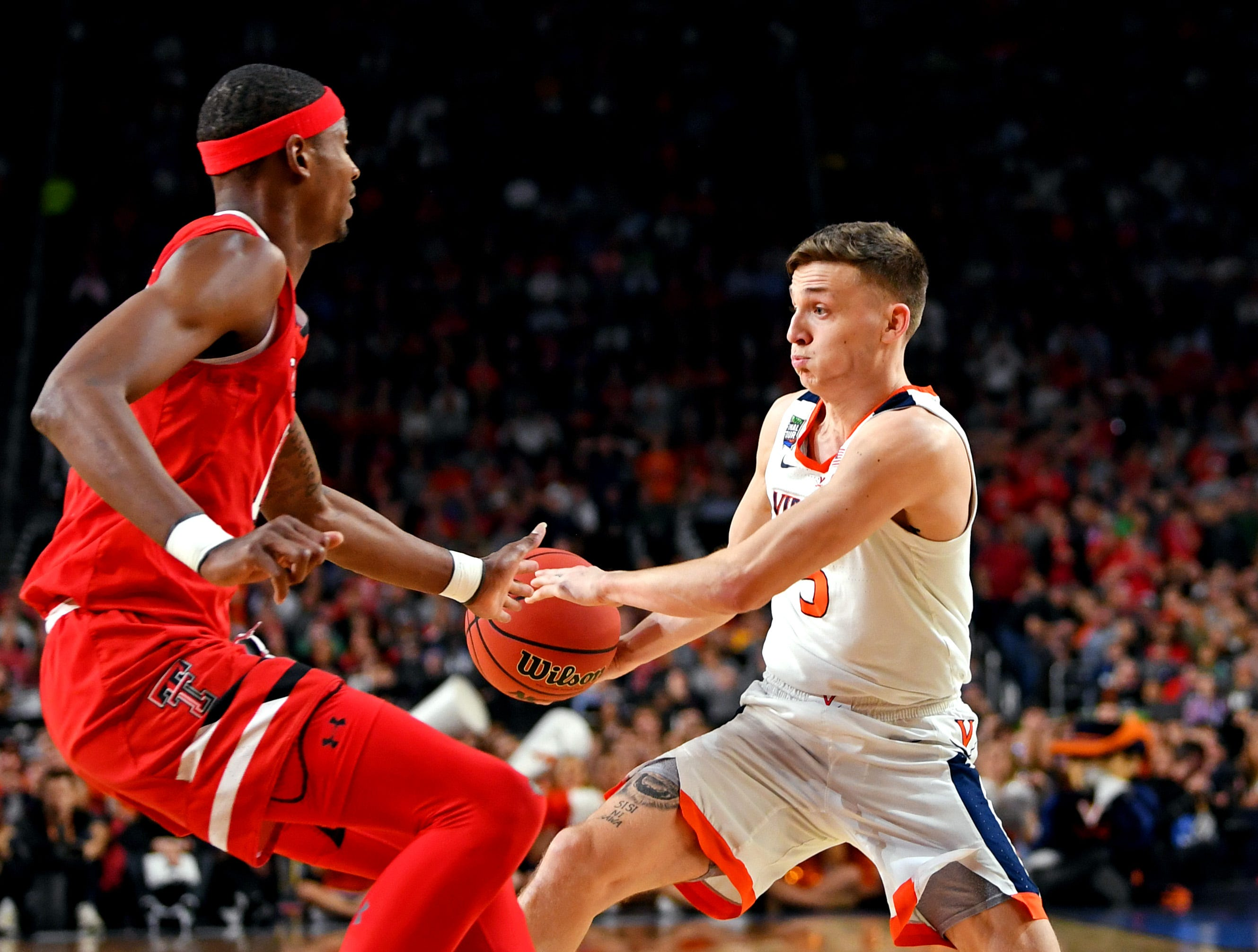 Apr 8, 2019; Minneapolis, MN, USA; Virginia Cavaliers guard Kyle Guy (5) passes the ball against Texas Tech Red Raiders forward Tariq Owens (11) during the first half in the championship game of the 2019 men's Final Four at US Bank Stadium. Mandatory Credit: Bob Donnan-USA TODAY Sports