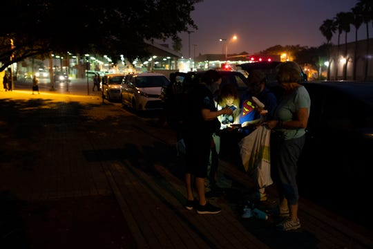 Team Brownsville volunteers Emmett Blake, Diane Beckman, Anne Rioux and Ann Finch of Austin before crossing the Gateway International Bridge to serve breakfast use a cellphone to read a list of shoes sizes needed for migrants waiting in Matamoros Mexico on Friday, April 5, 2019.