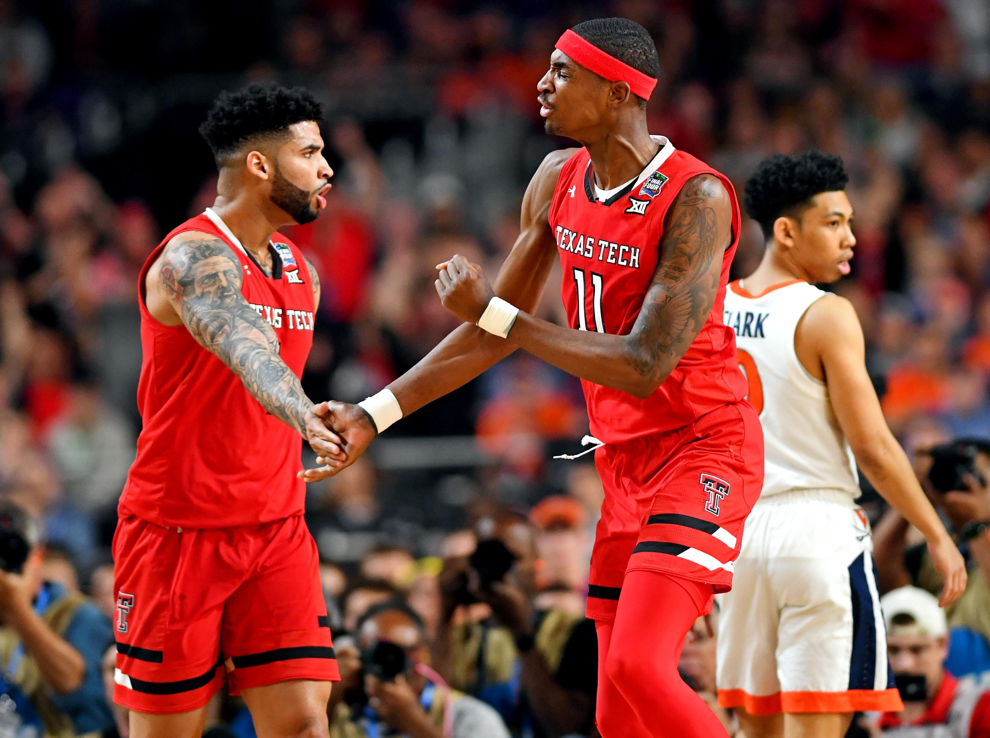 Apr 8, 2019; Minneapolis, MN, USA; Texas Tech Red Raiders forward Tariq Owens (11) celebrates with Texas Tech Red Raiders guard Kyler Edwards (0) during the first half against the Virginia Cavaliersin the championship game of the 2019 men's Final Four at US Bank Stadium. Mandatory Credit: Bob Donnan-USA TODAY Sports