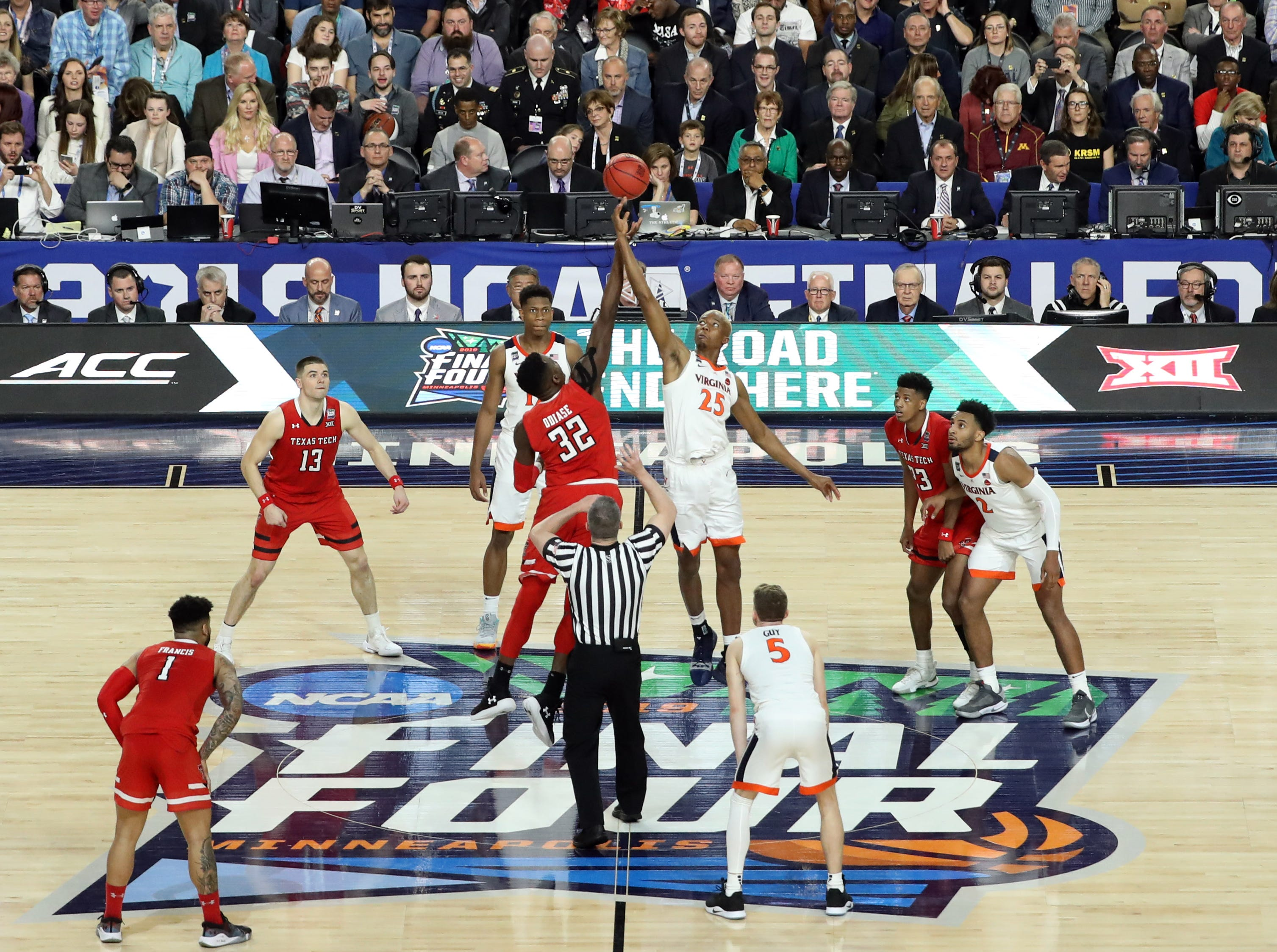 Apr 8, 2019; Minneapolis, MN, USA; The ball is tipped during overtime in the championship game of the 2019 men's Final Four between the Virginia Cavaliers and the Texas Tech Red Raiders at US Bank Stadium. Mandatory Credit: Brace Hemmelgarn-USA TODAY Sports
