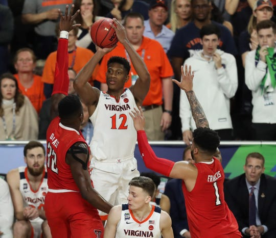 Apr 8, 2019; Minneapolis, MN, USA; Virginia Cavaliers guard De'Andre Hunter (12) hits a three point shot during the second half against the Texas Tech Red Raiders in the championship game of the 2019 men's Final Four at US Bank Stadium. Mandatory Credit: Brace Hemmelgarn-USA TODAY Sports