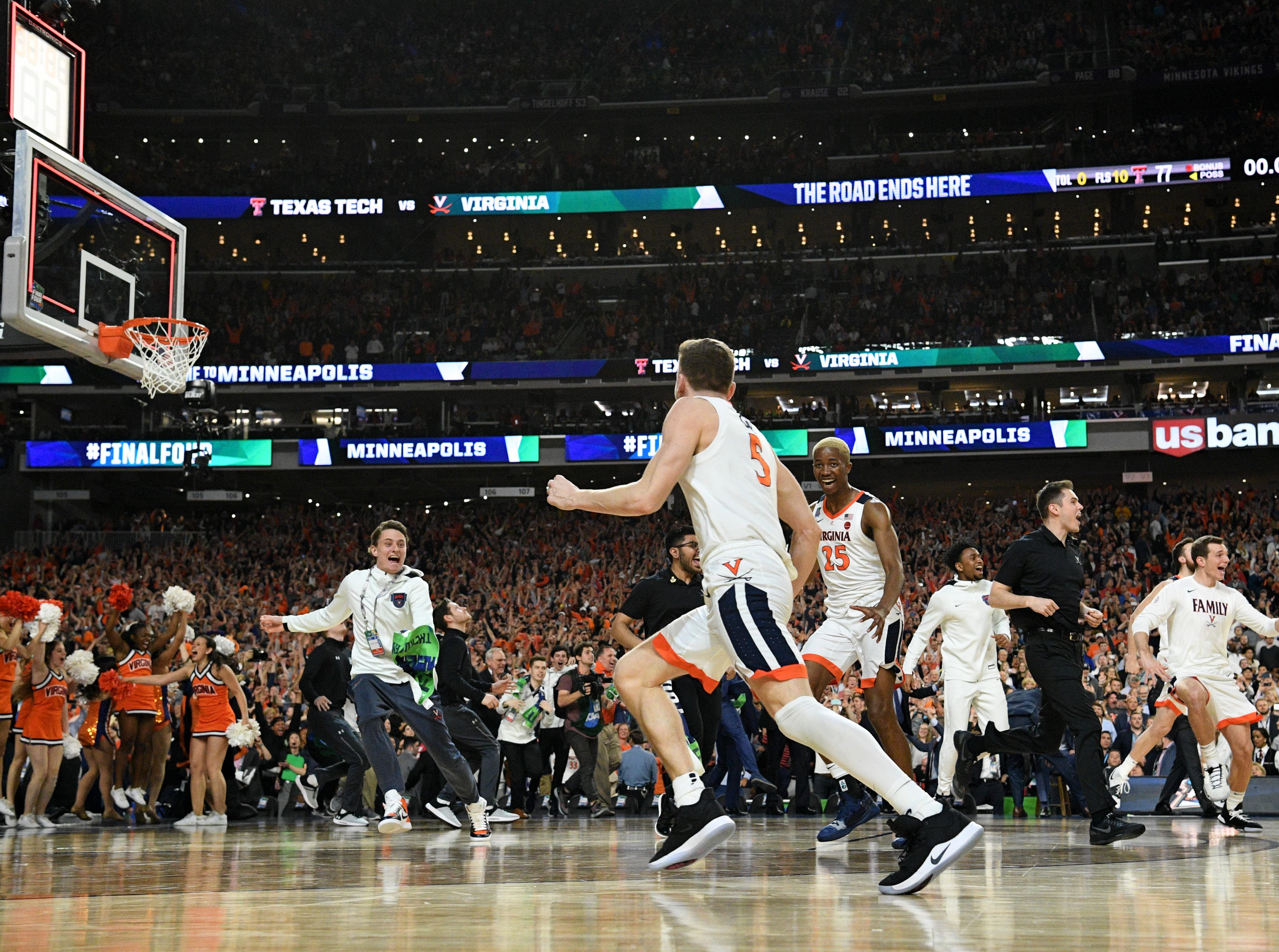 Apr 8, 2019; Minneapolis, MN, USA; Virginia Cavaliers guard Kyle Guy (5) celebrates with teammates after defeating the Texas Tech Red Raiders in the championship game of the 2019 men's Final Four at US Bank Stadium. Mandatory Credit: Robert Deutsch-USA TODAY Sports