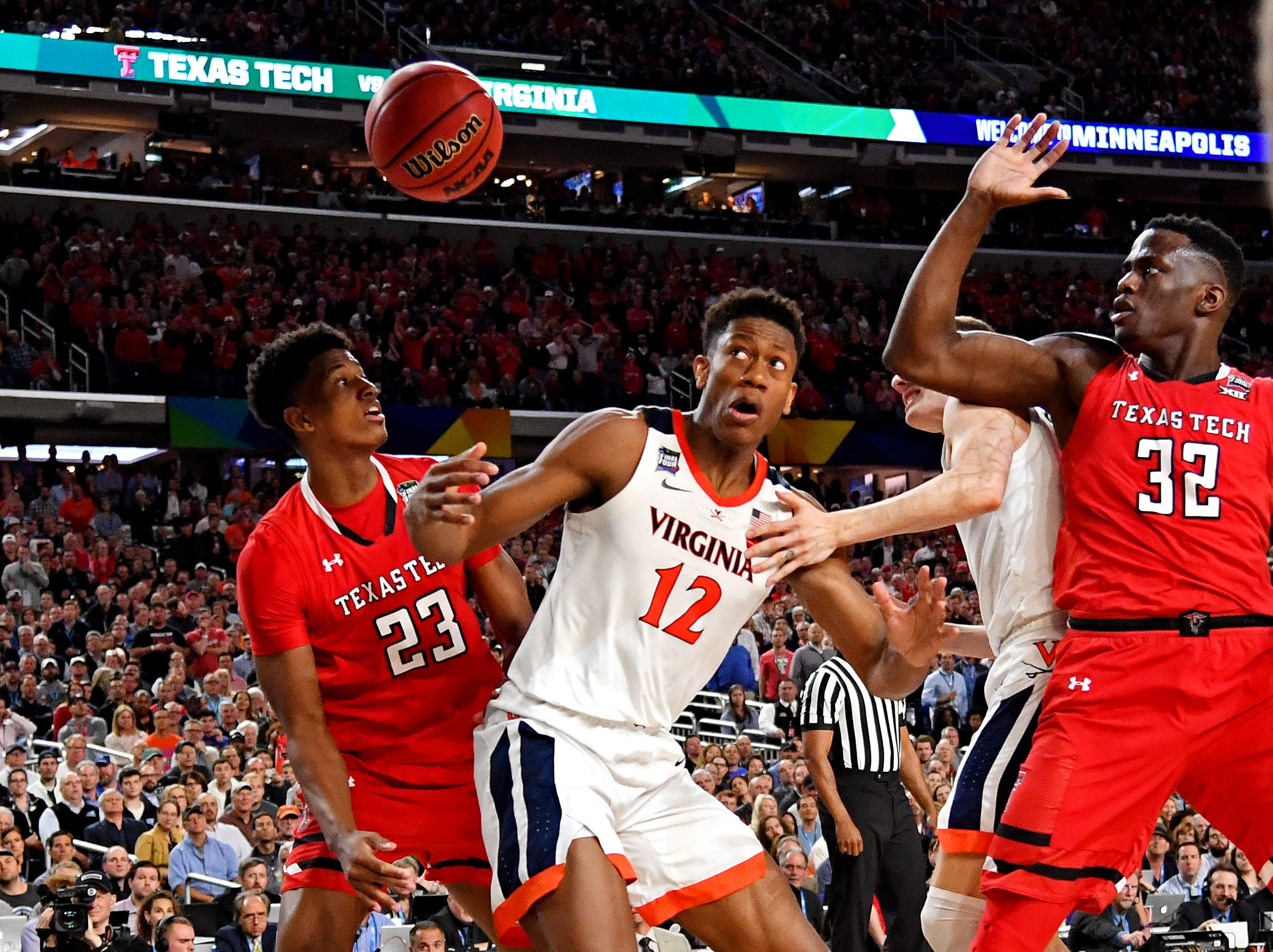 Apr 8, 2019; Minneapolis, MN, USA; Virginia Cavaliers guard De'Andre Hunter (12) and Texas Tech Red Raiders guard Jarrett Culver (23) go for a loose ball during the second half in the championship game of the 2019 men's Final Four at US Bank Stadium. Mandatory Credit: Bob Donnan-USA TODAY Sports