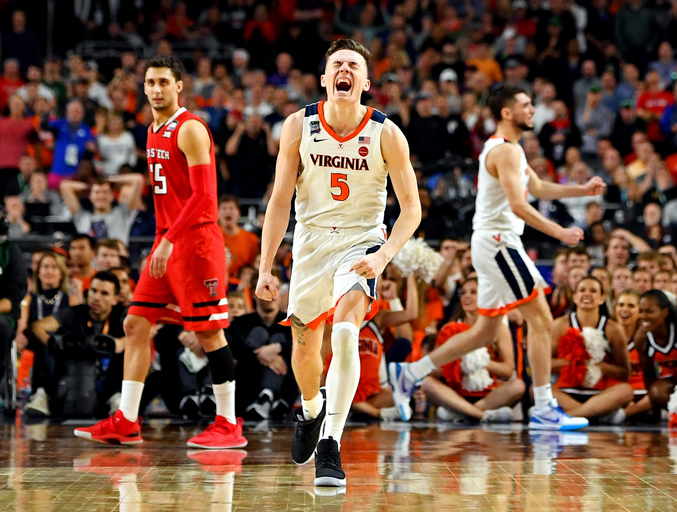 Apr 8, 2019; Minneapolis, MN, USA; Virginia Cavaliers guard Kyle Guy (5) celebrates during overtime against the Texas Tech Red Raiders in the championship game of the 2019 men's Final Four at US Bank Stadium. Mandatory Credit: Bob Donnan-USA TODAY Sports