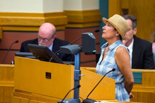 Sandy Murch, a resident of North Beach, speaks out against the recently proposed $40 million canal for North Beach during public comment at city council on Tuesday, April 9, 2019.