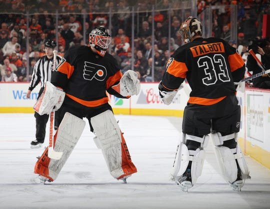 Brian Elliott, left, and Cam Talbot are both pending free agents who could stay with the Flyers to play with Carter Hart next season.