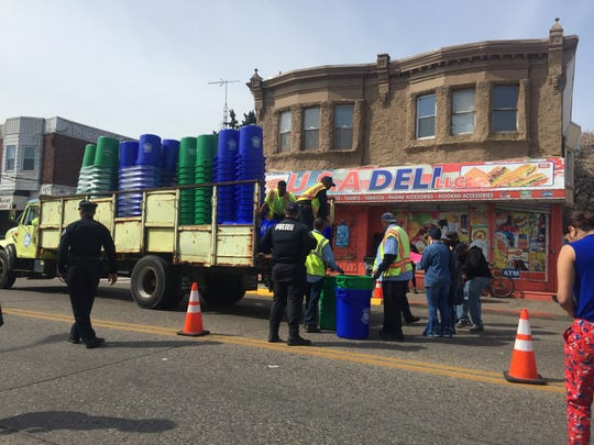 Camden Public Works employees give out trash and recycling receptacles along Mount Ephraim Avenue.