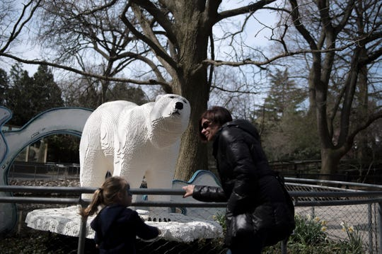 Guests check out a LEGO polar bear made of 95,000 bricks at the Philadelphia Zoo on Thursday, April 4, 2019.