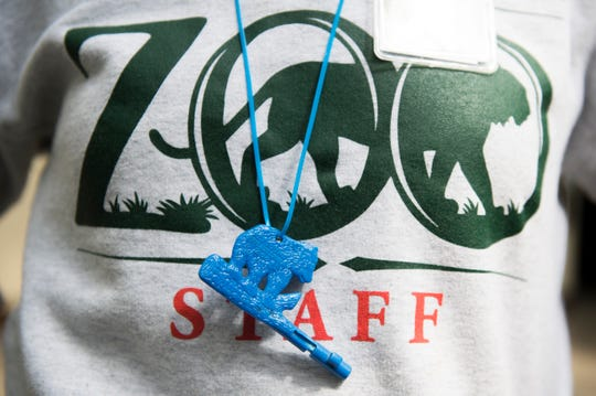 Danielle Hogan of Woodbury wears her Zoo Key while offering a tour of the Philadelphia Zoo on  Thursday, April 4.