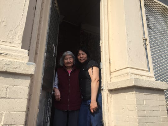Jenny Lam (left) has lived on Mount Ephraim Avenue for 30 years. Her home health aide, Sovanny Lam, translated for her; the 86-year-old said in Vietnamese that she hopes to see more businesses along the avenue.
