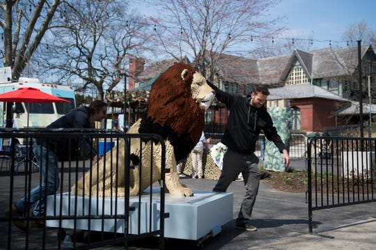 A LEGO lion is carted from a media event in Urban Green to its exhibit location at the Philadelphia Zoo on Thursday, April 4, 2019.