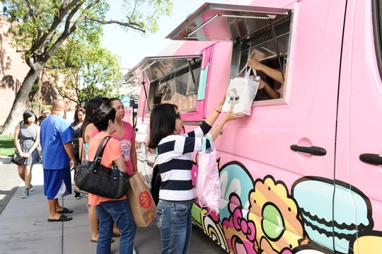 Fans of  Hello Kitty line up for a turn at the Hello Kitty Cafe Truck.
